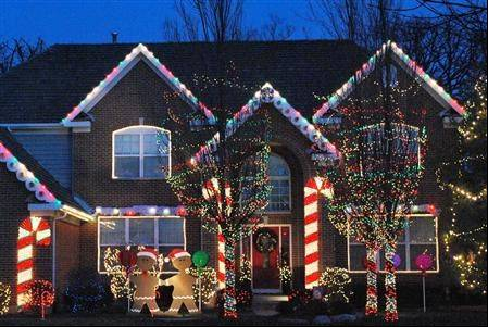 Giant candy canes made of rope lights along with gumdrop fascia boards are the highlight of the Cramer family's giant gingerbread house at 409 Morgan St. in Fox River Grove.