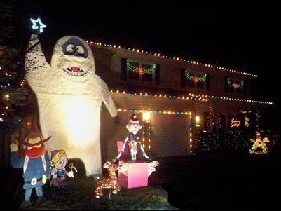 "The Coglianese family wishes everyone a Merry Christmas with a 14-foot Bumbles and a cast of characters from ""Rudolph the Red-Nosed Reindeer"" at 611 W. Berkley Drive in Arlington Heights."