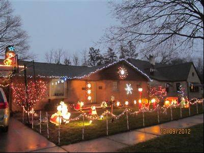 "The Navaroo family has fun decorating each year at 309 S. Second St. in West Dundee. ""It's been a tradition ever since we moved in 15 years ago. Our children enjoy putting up the manger scene and planning where everything will go,"" Chris says. ""Don't forget to look up and see Santa bicycling his way north."""