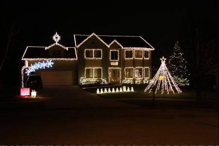 "The Syers family puts on a synchronized show at The Magical House on (1347) Hunter Circle in Naperville. The display features 112 Light-O-Rama channels controlling over 21,000 lights dancing to music on 106.9-FM. Ther show contains 13 songs and runs daily from 5 p.m. to midnight (http://www.TheMagicalHouseOnHunterCircle.com). ""Last year we raised $1,000 for the Make-A-Wish foundation and we hope to raise even more money this year,"" John Syers says."