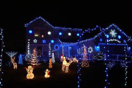 "Christmakah on Foxmoor is the title of the decorations at this house at 1411 Foxmoor Lane in Elgin. ""To celebrate both Christmas and Hanukkah, we decorate our house in blue and white lights. In addition, we have a handmade menorah and Star of David,"" said Jenny T."