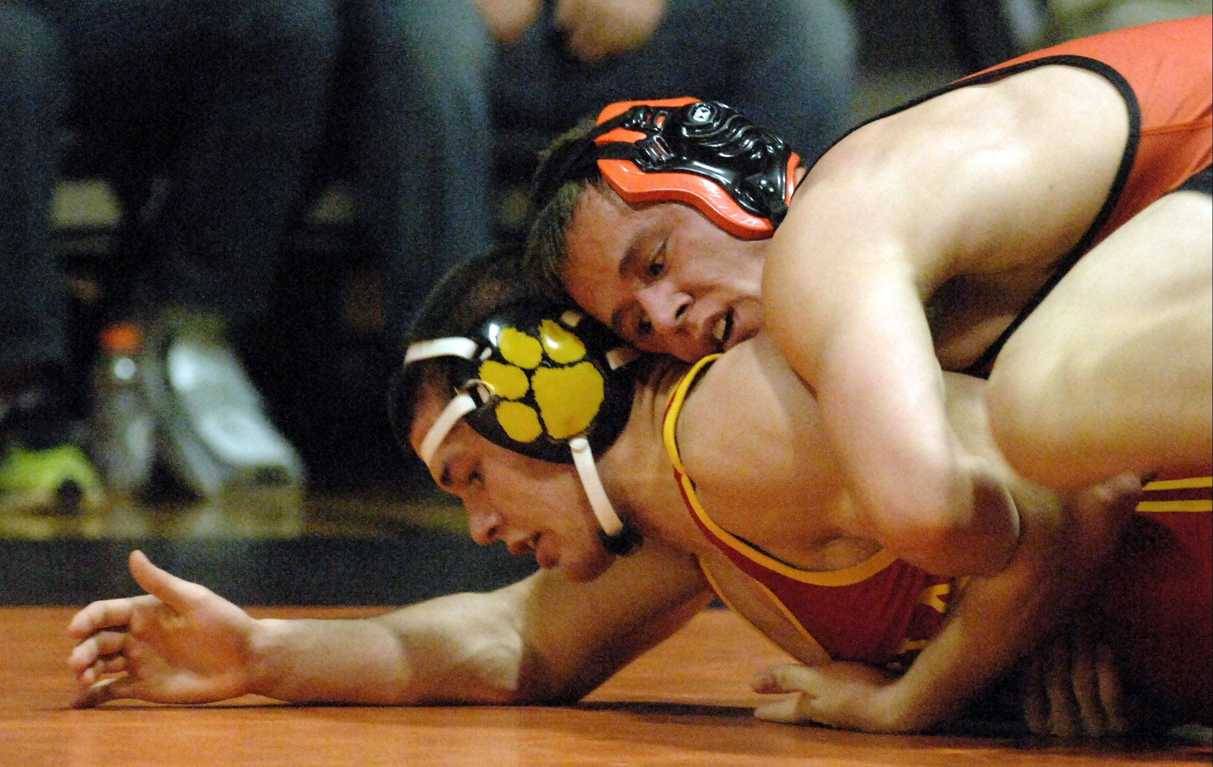St. Charles East's Jordan Meadows defeated Batavia's Noah Frazier at 182 pounds Thursday at St. Charles East.