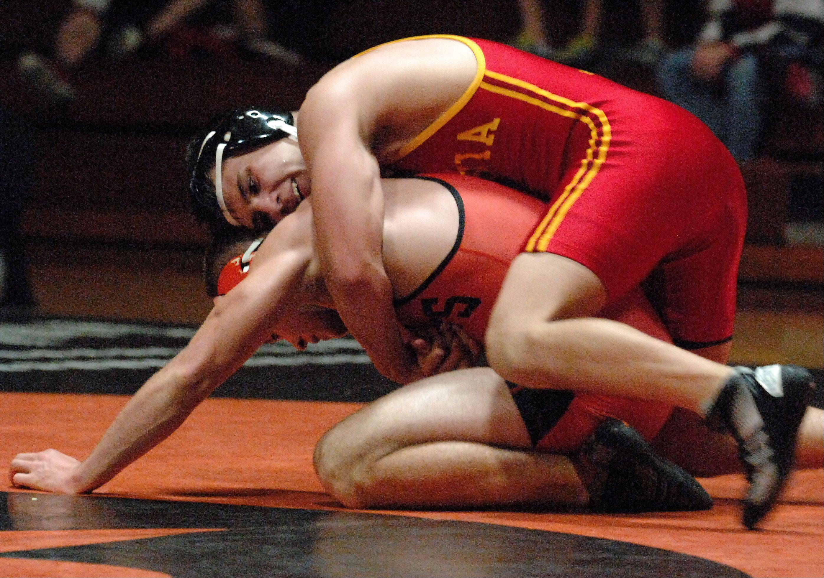Batavia's Jon Wagner beat St. Charles East's Brad Kearbey in the 160-pound division during Thursday's wrestling action at St. Charles East.
