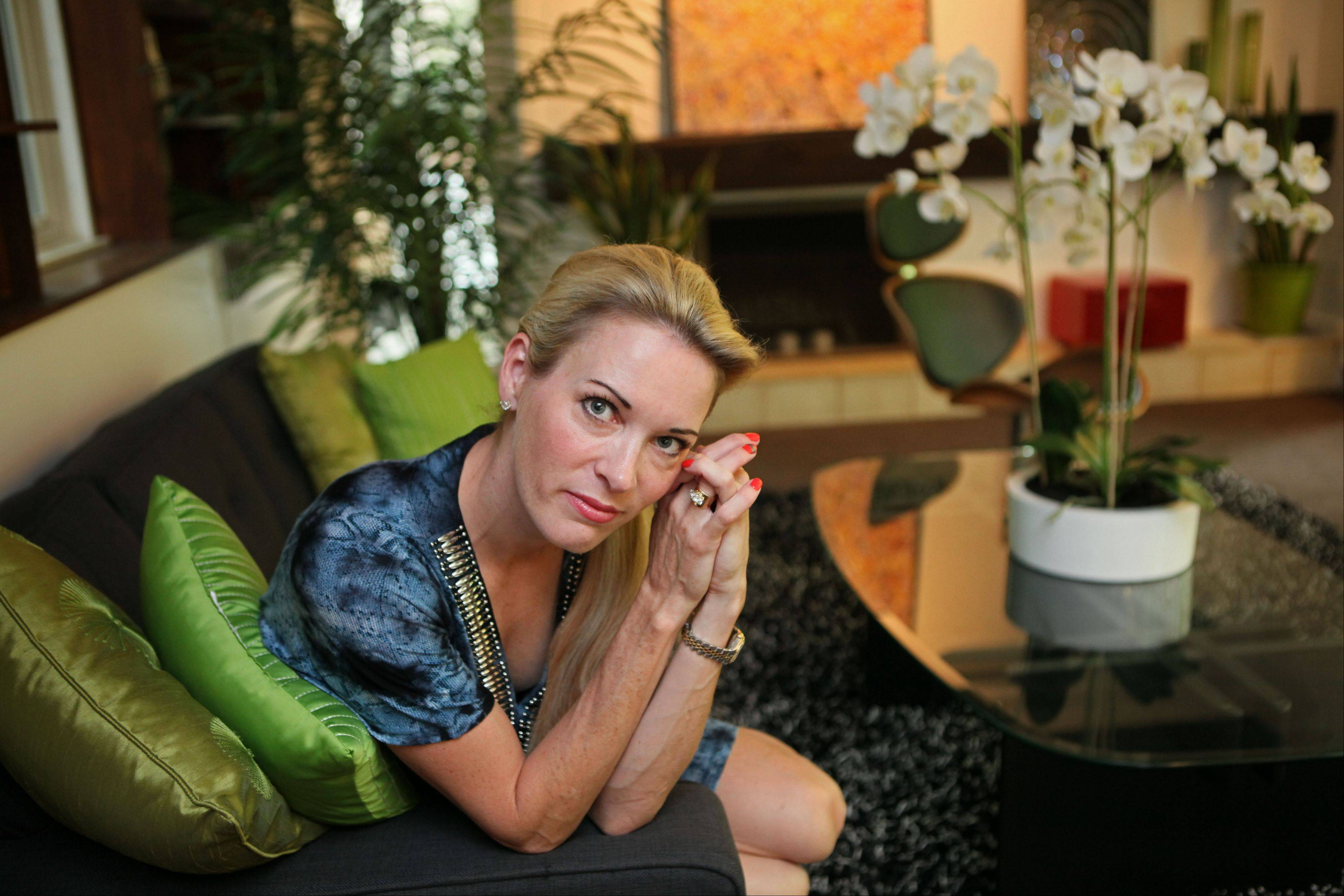 Suzy Favor Hamilton, shown here in her Madison, Wis., home last July, has admitted leading a double life as an escort. The three-time Olympian apologized Thursday after a report said she had been working as a prostitute in Las Vegas.