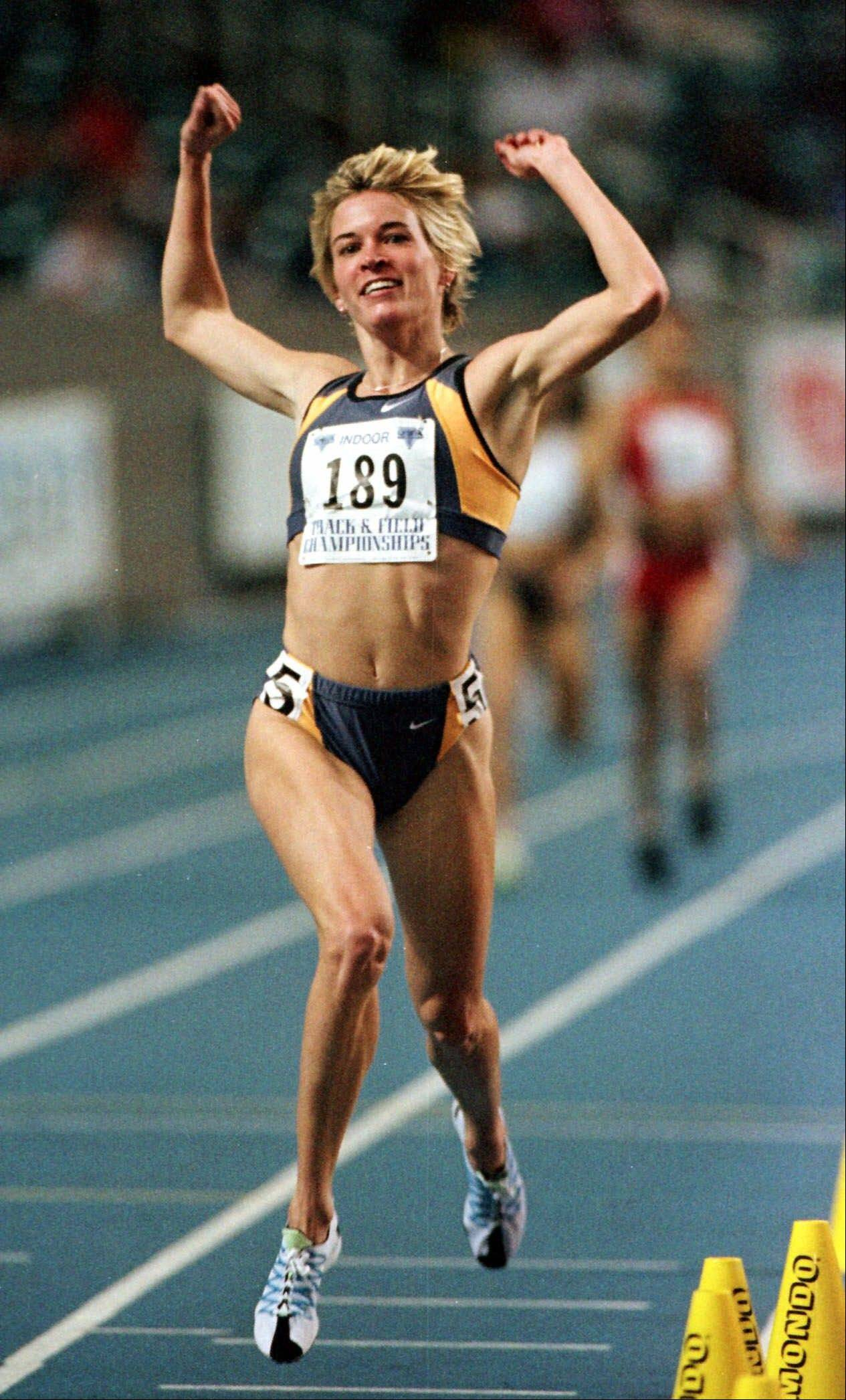 Suzy Hamilton reacts after winning the women's 1,500 meter run with a time of 4:13.96 at the USA Championships athletics meet in Atlanta in 1990. The three-time Olympian and Big Ten track icon has admitted leading a double life as an escort.