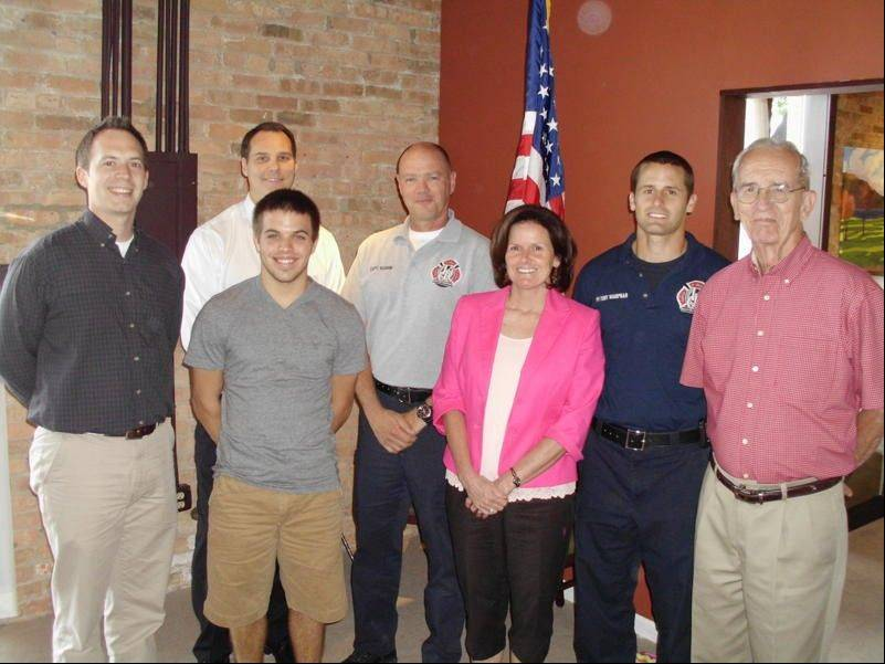 St. Charles Noon Rotary Club Officers Scott Piner and Mark Nyman congratulate two scholarship winners, Matt O'Brien and Chistopher Wampnar and their families: Margie Wampnar, Powell Douglas and Fire Dept. Captain Scott Vaughn.