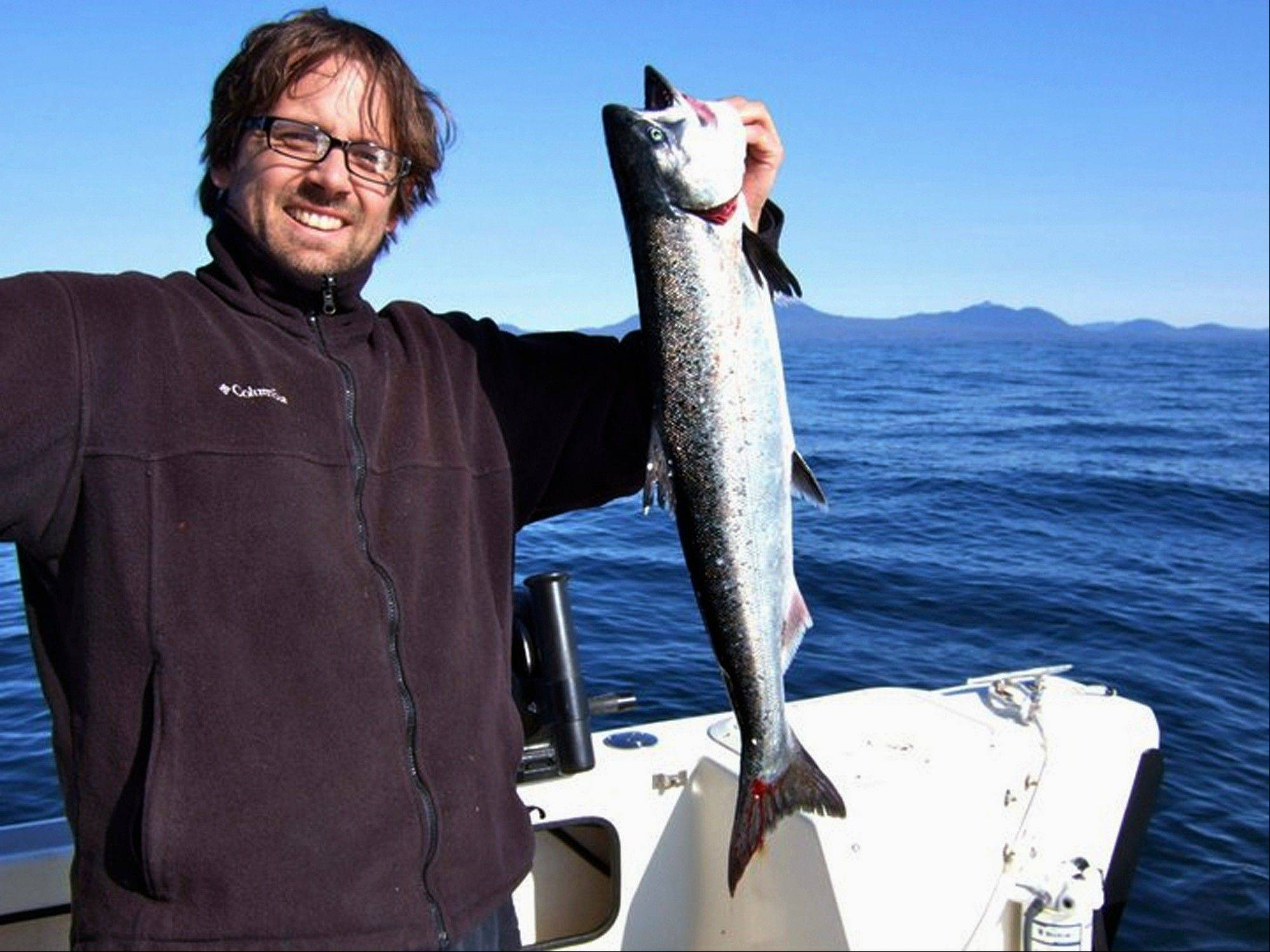 Nic Mink of Sitka Salmon Shares in Galesburg, Ill., holds up a freshly caught king salmon seven miles southwest of Sitka, Alaska. Mink is president of one of Galesburg�s most successful start-up companies. Congressional opposition to an engineered fish has so far been led by members of the Alaska delegation, who see the modified salmon as a threat to the state�s wild salmon industry.