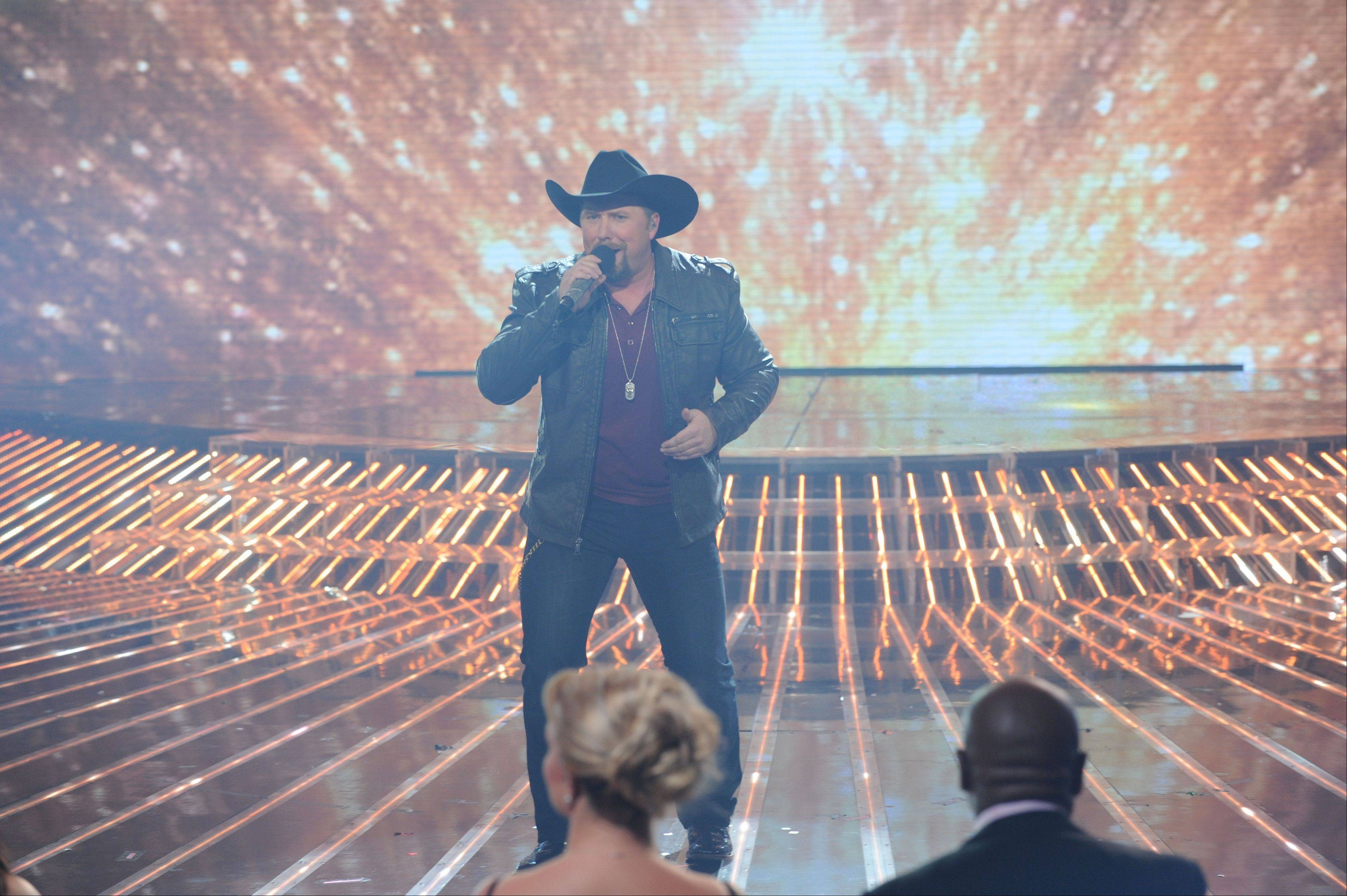 Season two winner Tate Stevens performs during �The X Factor� finale Thursday.