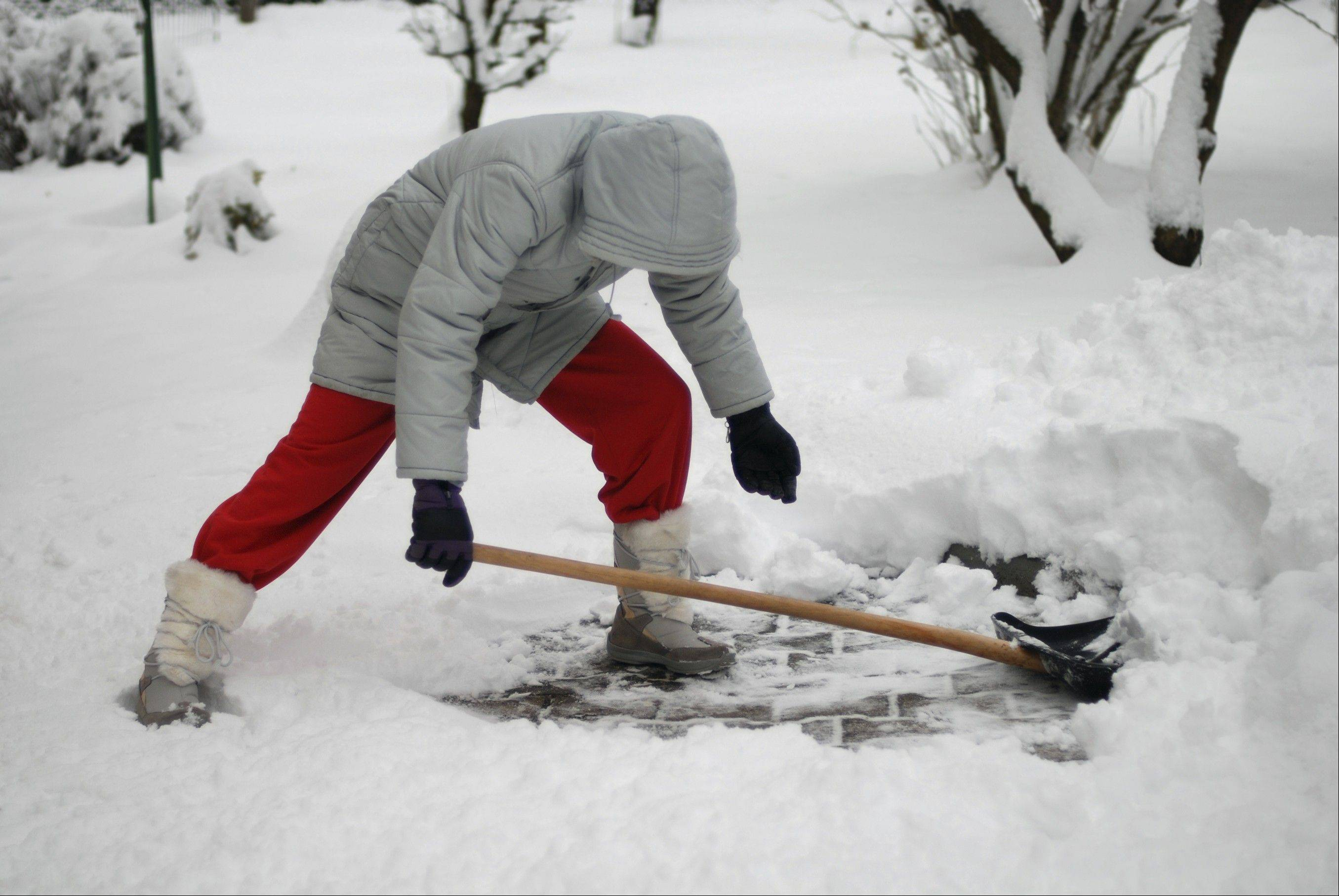 Stay hydrated and take frequent breaks when you shovel snow, experts advise.