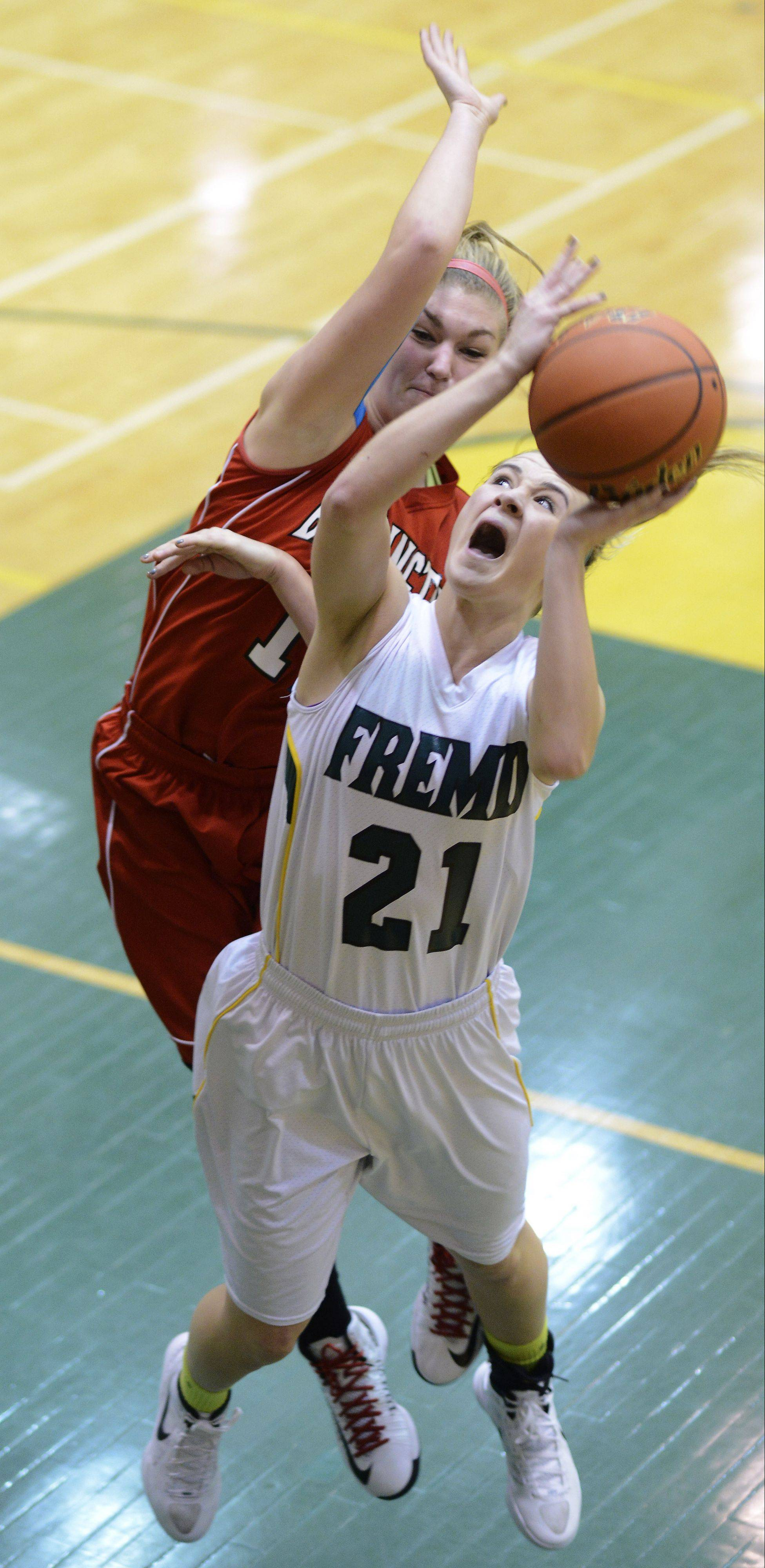 Fremd's Ashley McConnell gets fouled by Barrington's Maddie Bartz on a drive to the basket during Friday's game.