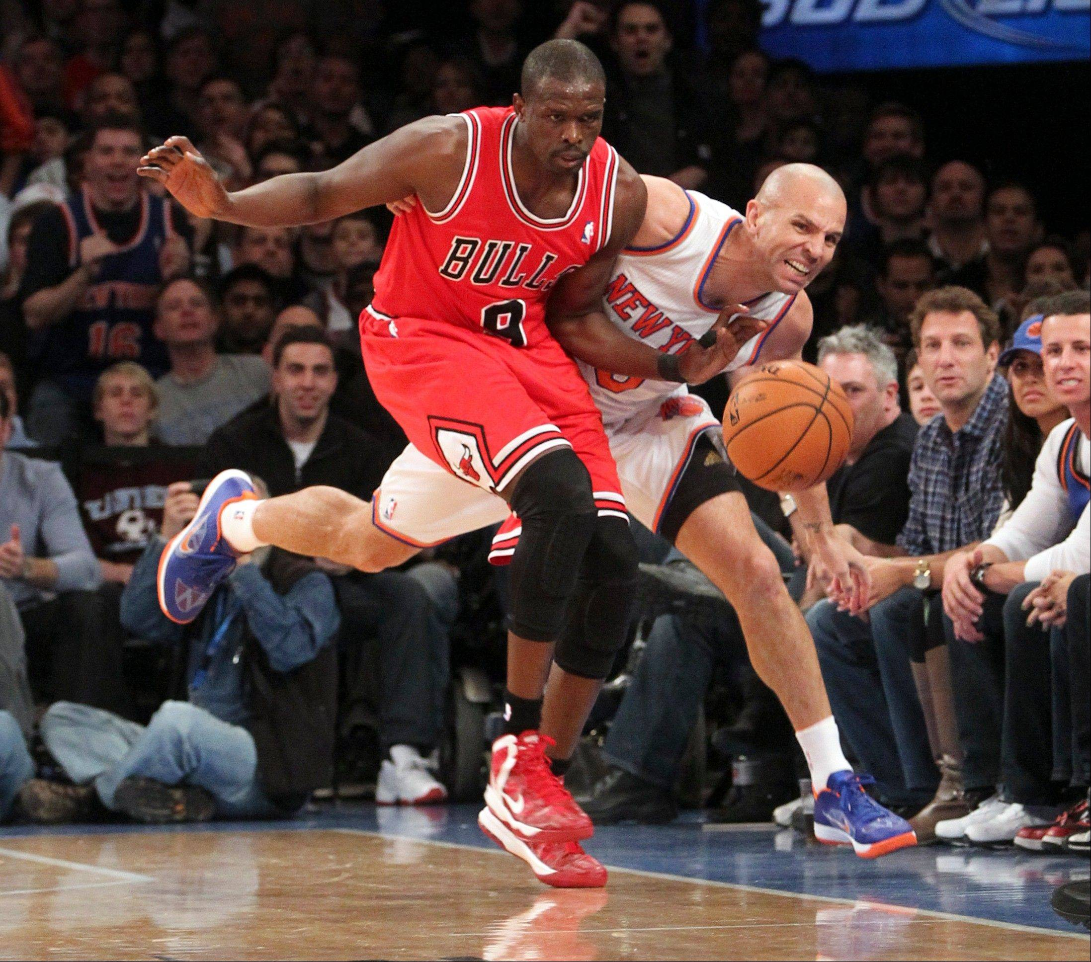 Bulls forward Luol Deng, left, and New York Knicks' Jason Kidd chase a loose ball Friday during the first half at Madison Square Garden in New York.