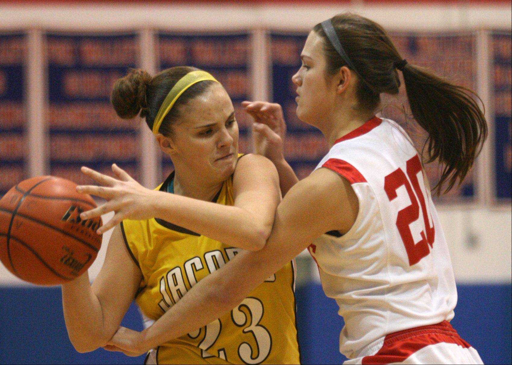 Jacobs� Tiffany Frighetto, left, tries to get past Dundee-Crown�s Franchesca Cavallaro.