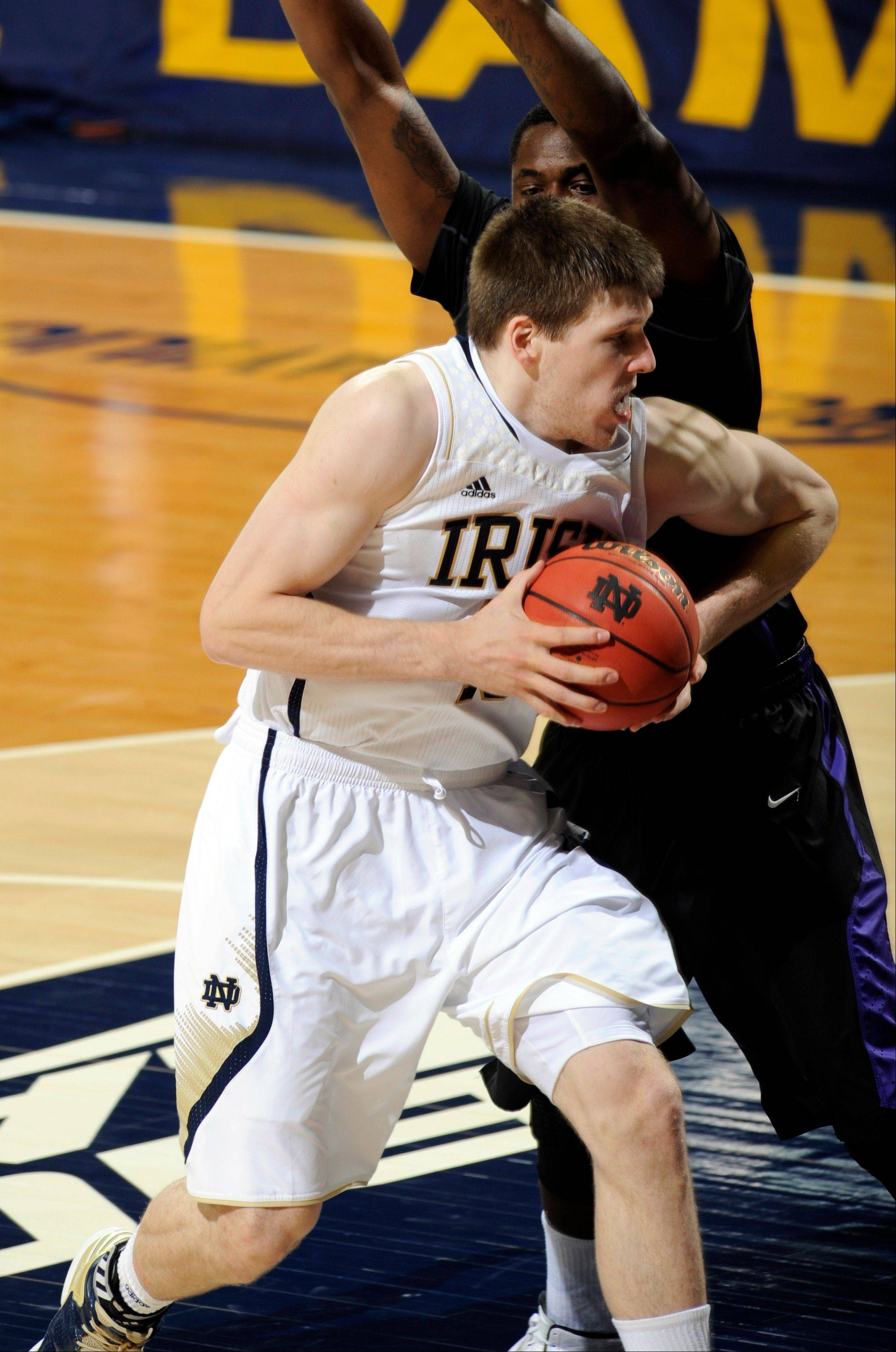 Notre Dame forward Jack Cooley, front, drives the lane Friday during the second half against Niagara in South Bend, Ind. Notre Dame won 89-67 with Cooley leading all scorers with 24 points.