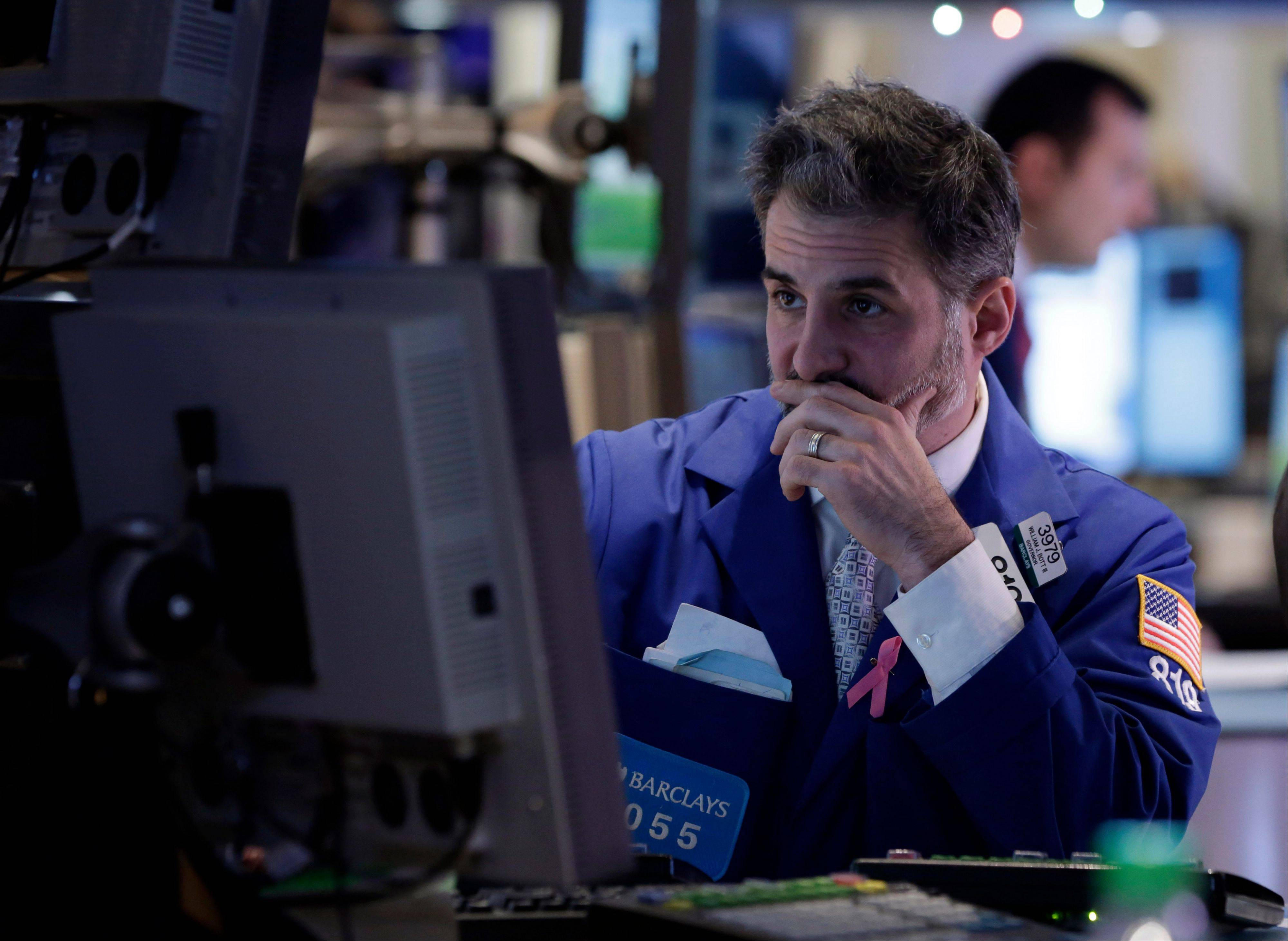 Specialist Anthony Rinaldi works Friday on the floor of the New York Stock Exchange.