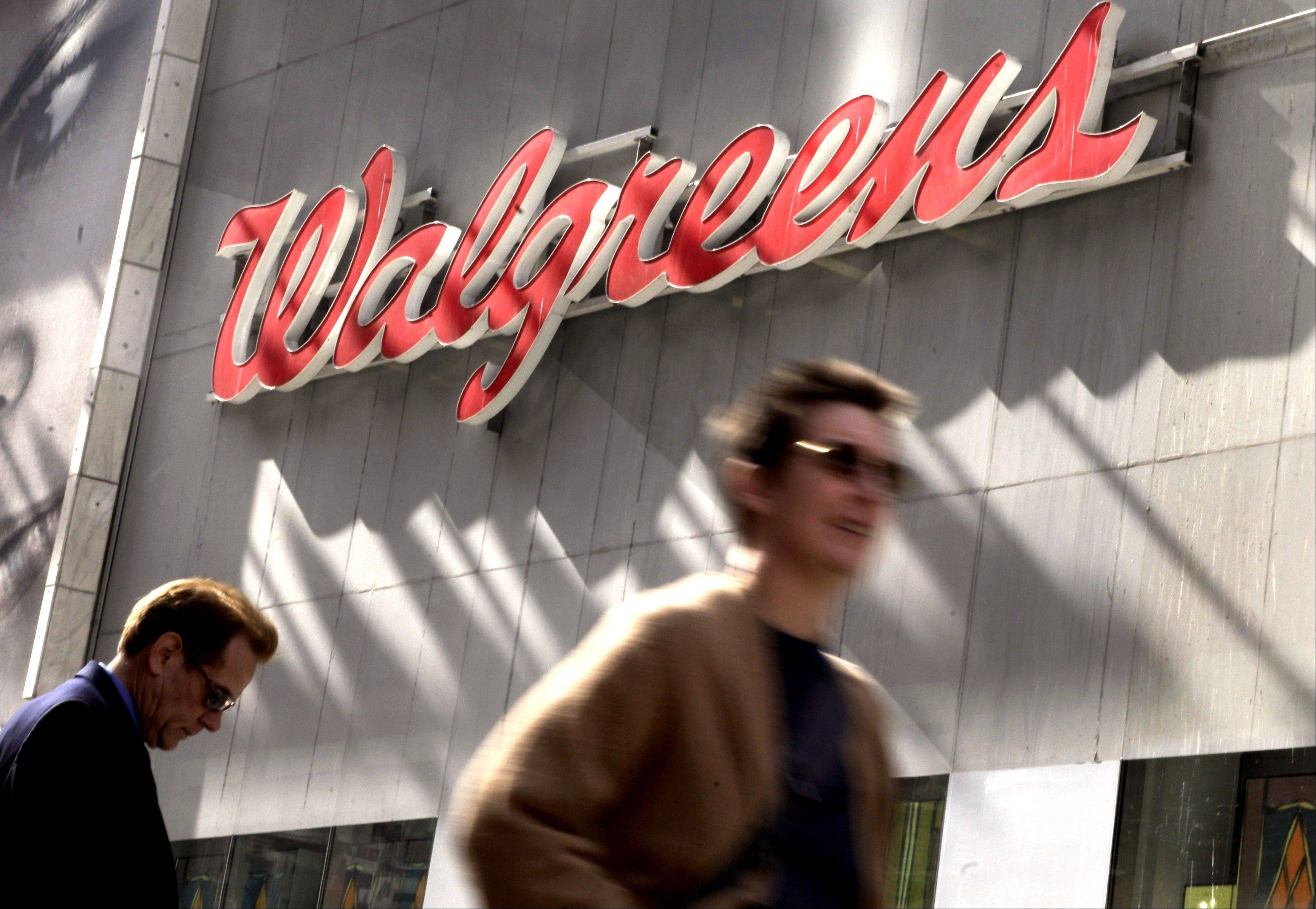 Walgreen Co.'s fiscal first-quarter earnings sank nearly 26 percent as the nation's largest drugstore chain filled fewer prescriptions and absorbed costs tied to acquisitions and Superstorm Sandy.