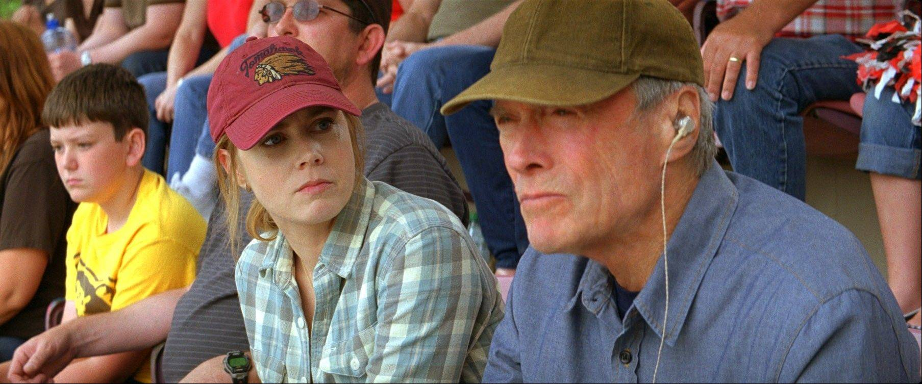 "Mickey (Amy Adams) tries to help her aging baseball scout father (Clint Eastwood) keep his job in Robert Lorenz's ""Trouble With the Curve."""