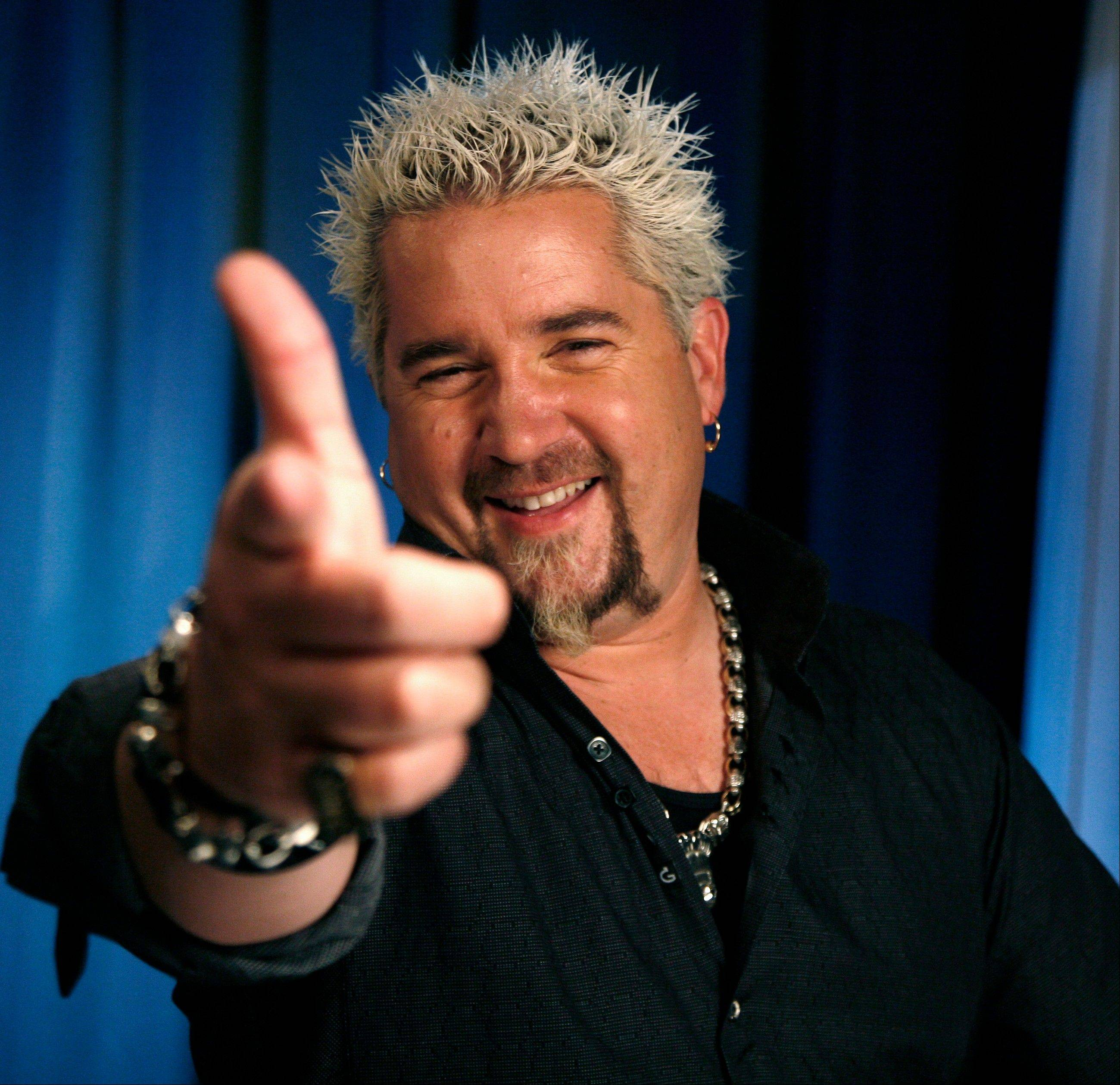 TV personality Guy Fieri's Times Square restaurant -- Guy's American Kitchen & Bar -- snagged a scathing review in The New York Times.