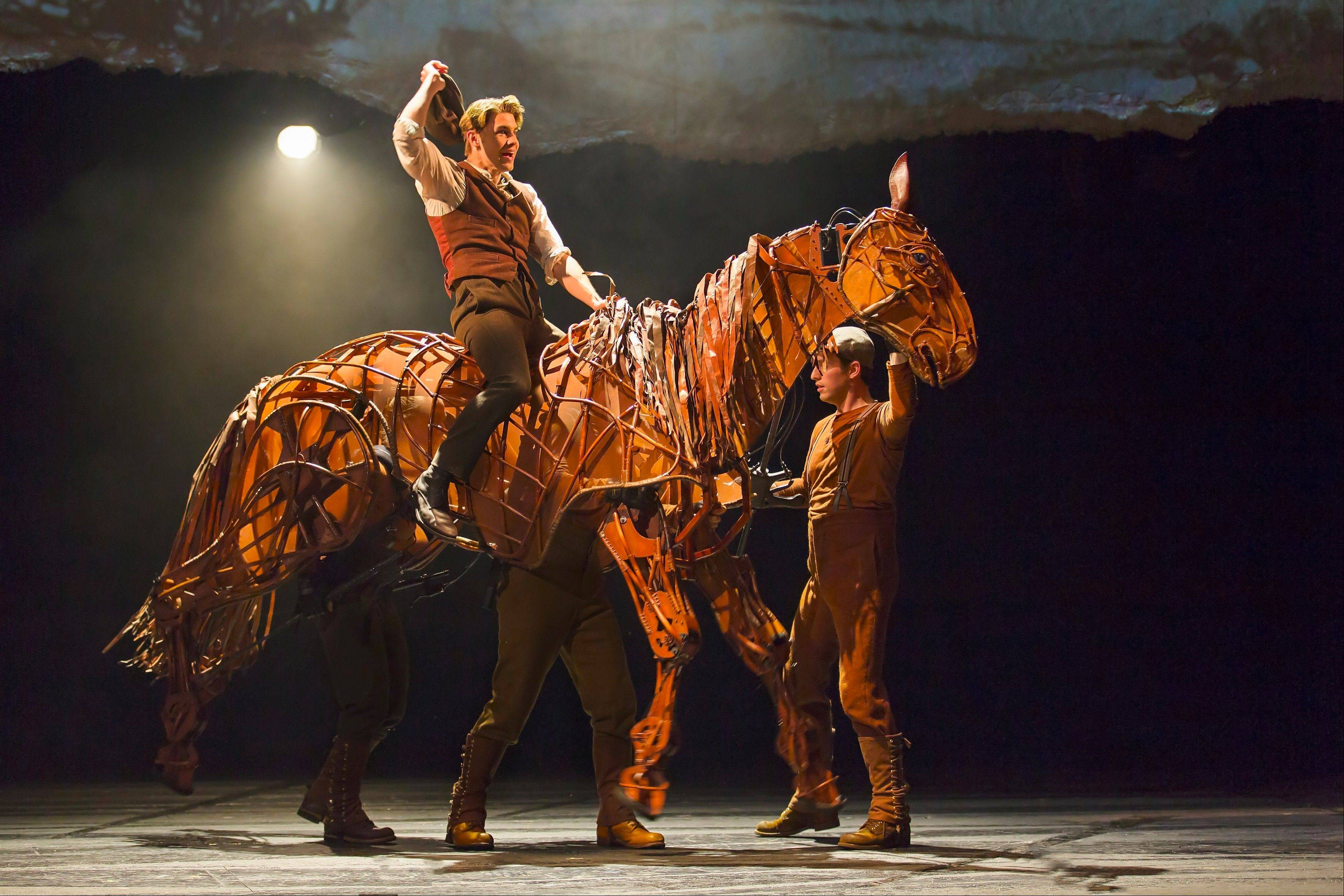 "Albert (Andrew Veenstra) rides his family's horse, Joey (manipulated by John Riddleberger, Patrick Osteen and Jessica Krueger), in the North American tour of ""War Horse,"" playing Chicago's Cadillac Palace Theatre now through Saturday, Jan. 5."