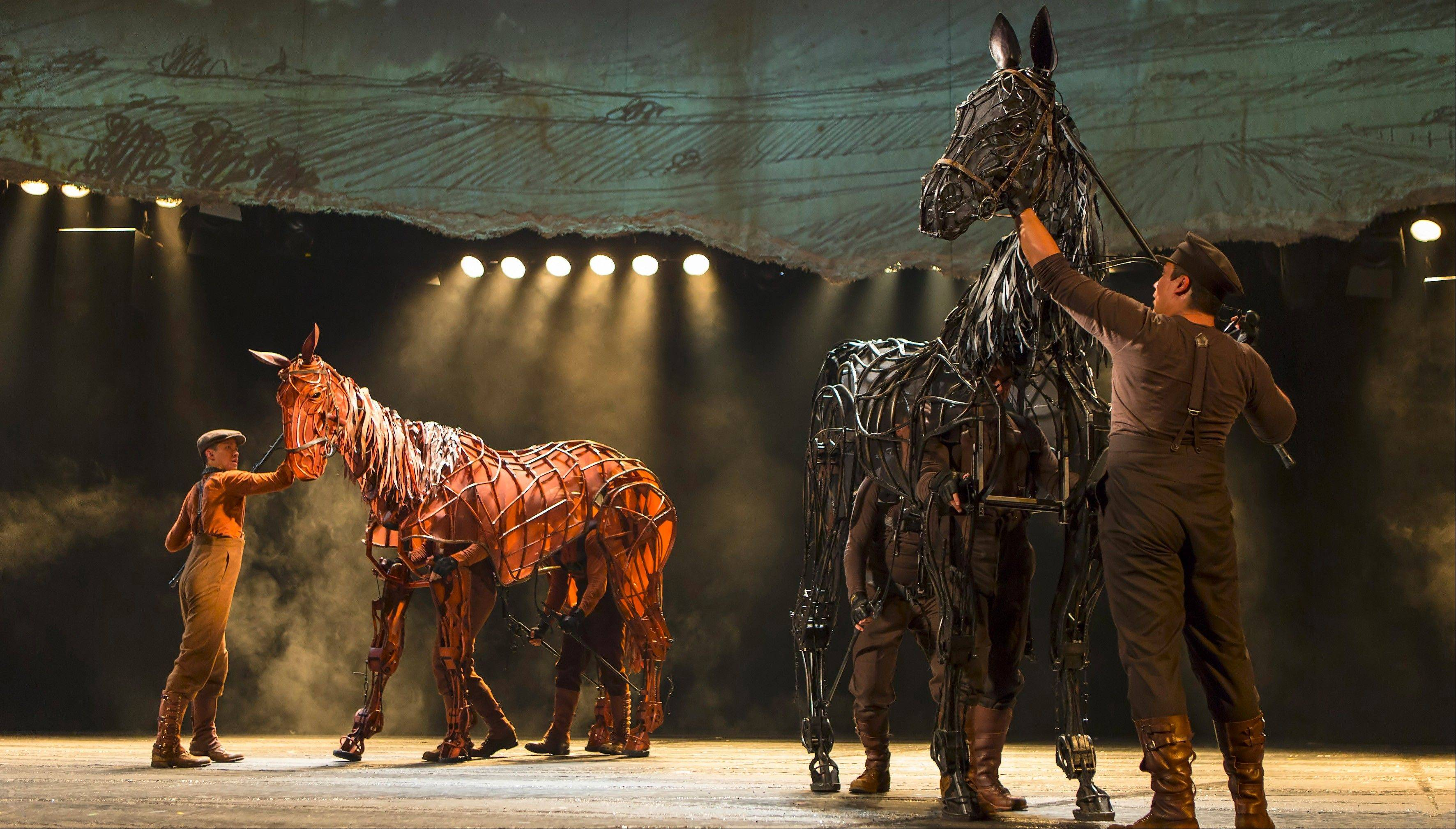 "Joey, left, is forced to spar with Topthorn in the North American tour of ""War Horse,"" playing Chicago's Cadillac Palace Theatre now through Saturday, Jan. 5."