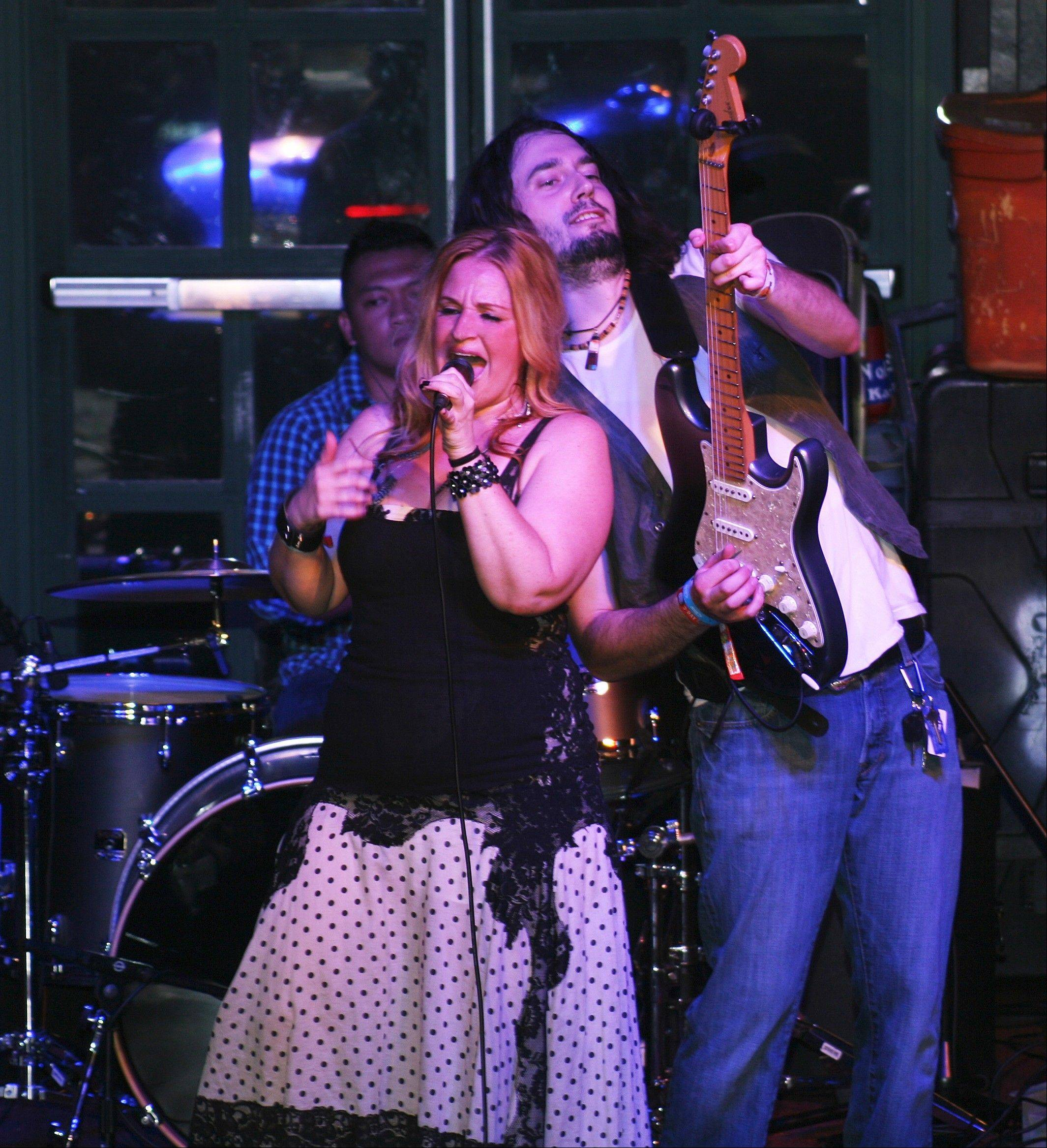Northbrook's Lauren Wolf, left, and her bandmates plan to record a second album come spring. They won a national contest that landed them a gig at the House of Blues on Thursday, Dec. 27.