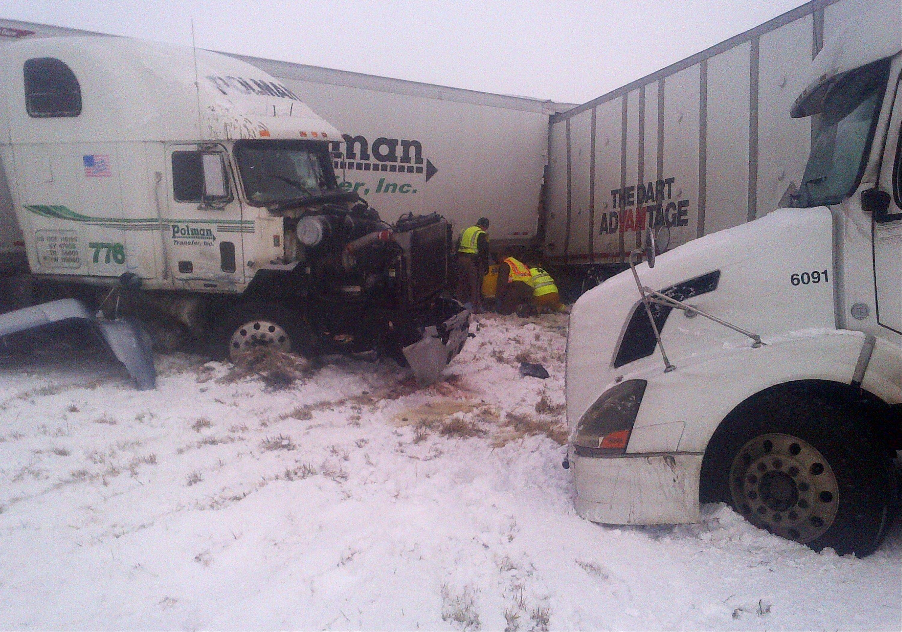 The scene of a 25-vehicle pileup that killed two people and injured several others Thursday on Interstate 35, about 60 miles north of Des Moines, Iowa.