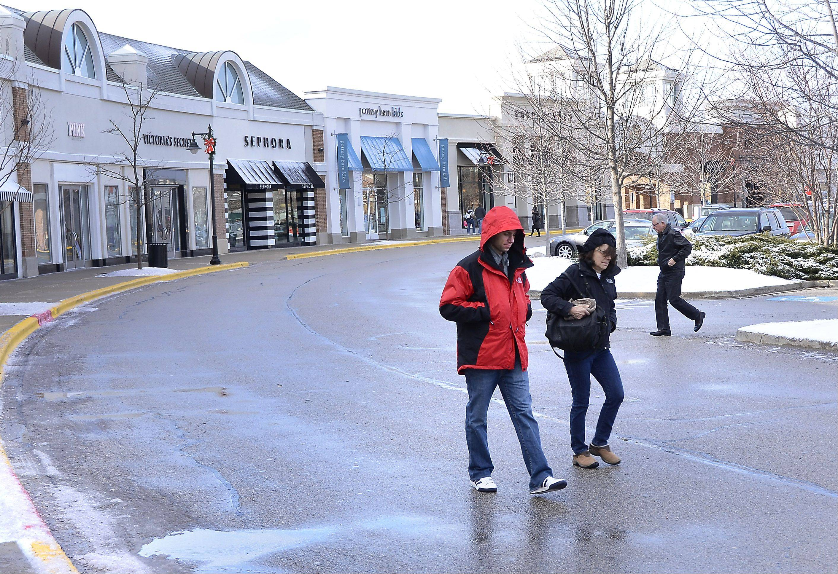 Shoppers at Deer Park Town Center kept hands in their pockets and heads down as they hustled to and from stores Friday afternoon. Temperatures in the 20s and winds gusting to 40 mph. were fitting for the first day of winter.