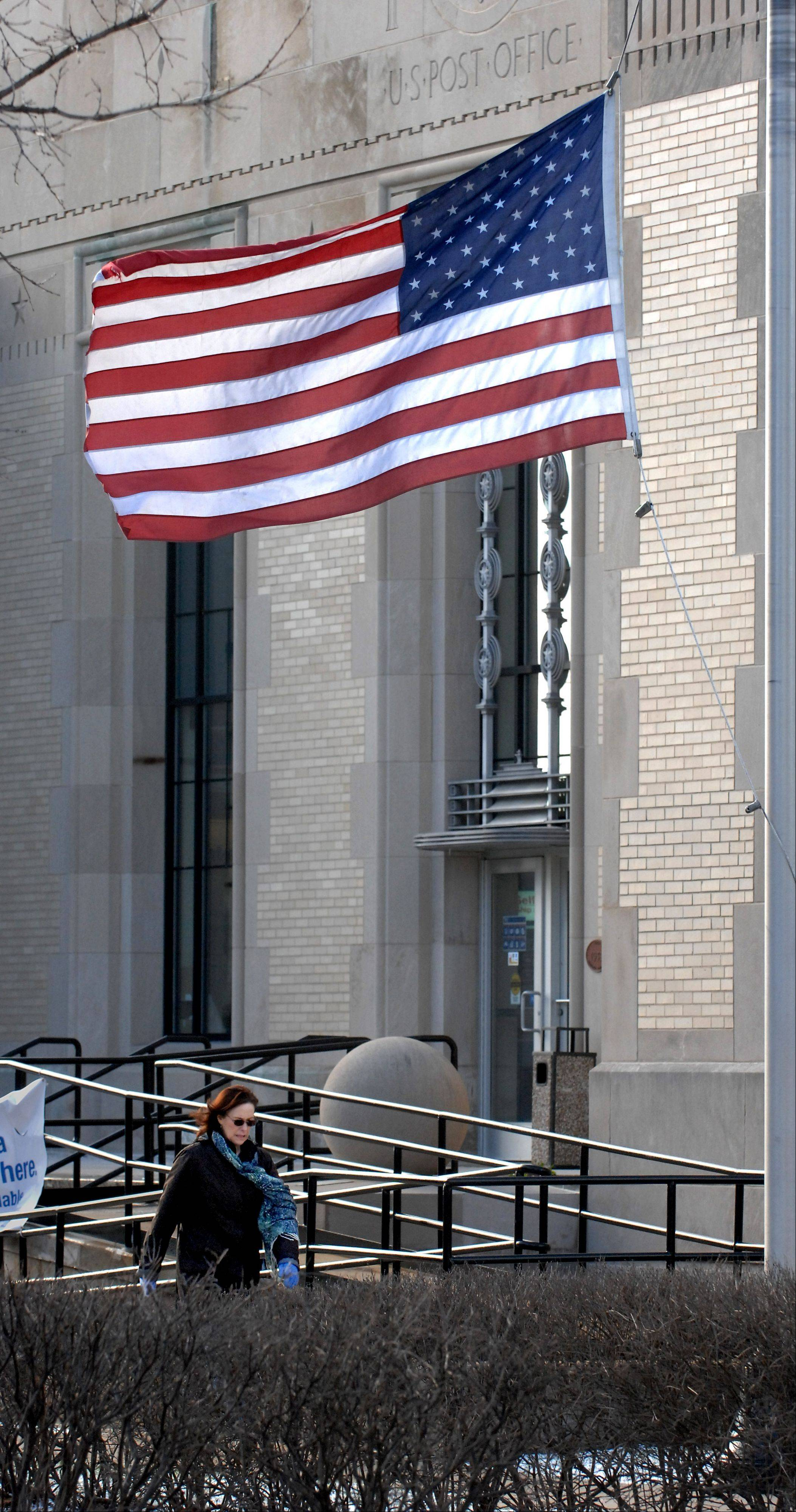 Winds were whipping flags and people around Friday morning, including those conducting last minute business at the Wheaton post office.