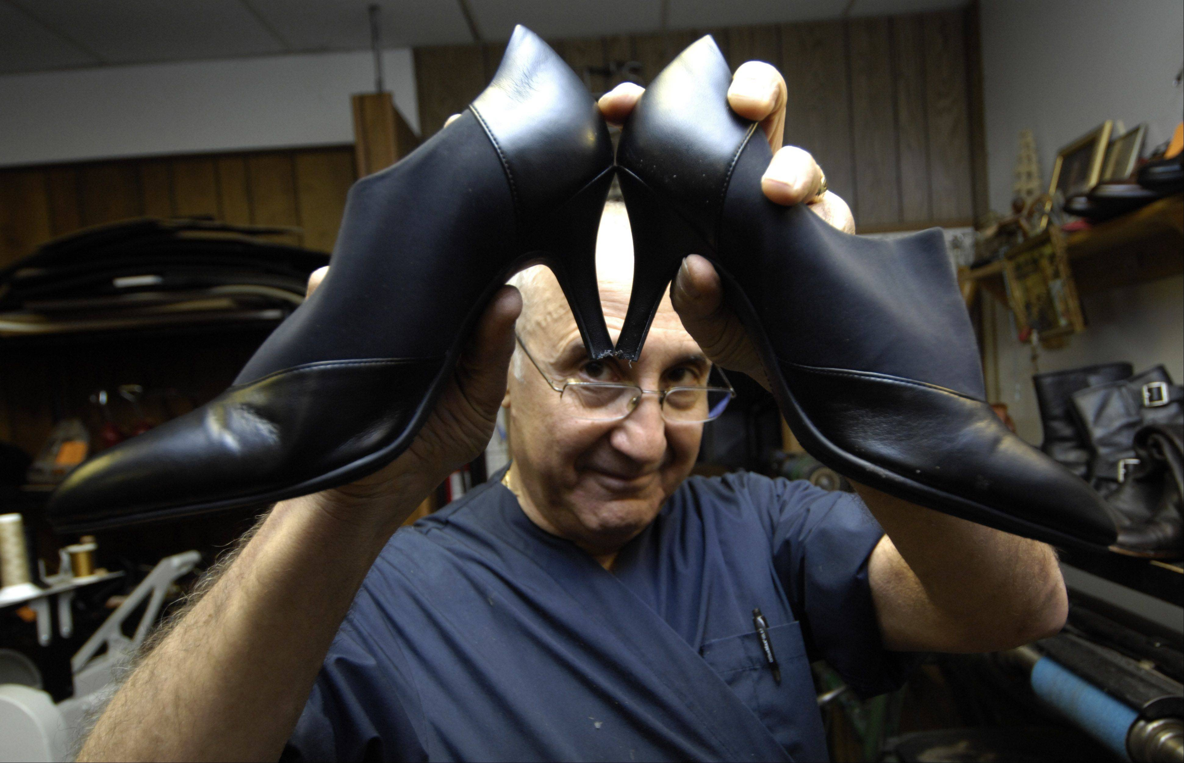 Larry DeAngelo makes sure the heals on a pair of shoes are even during a repair at Al's Shoe Service in Mount Prospect.