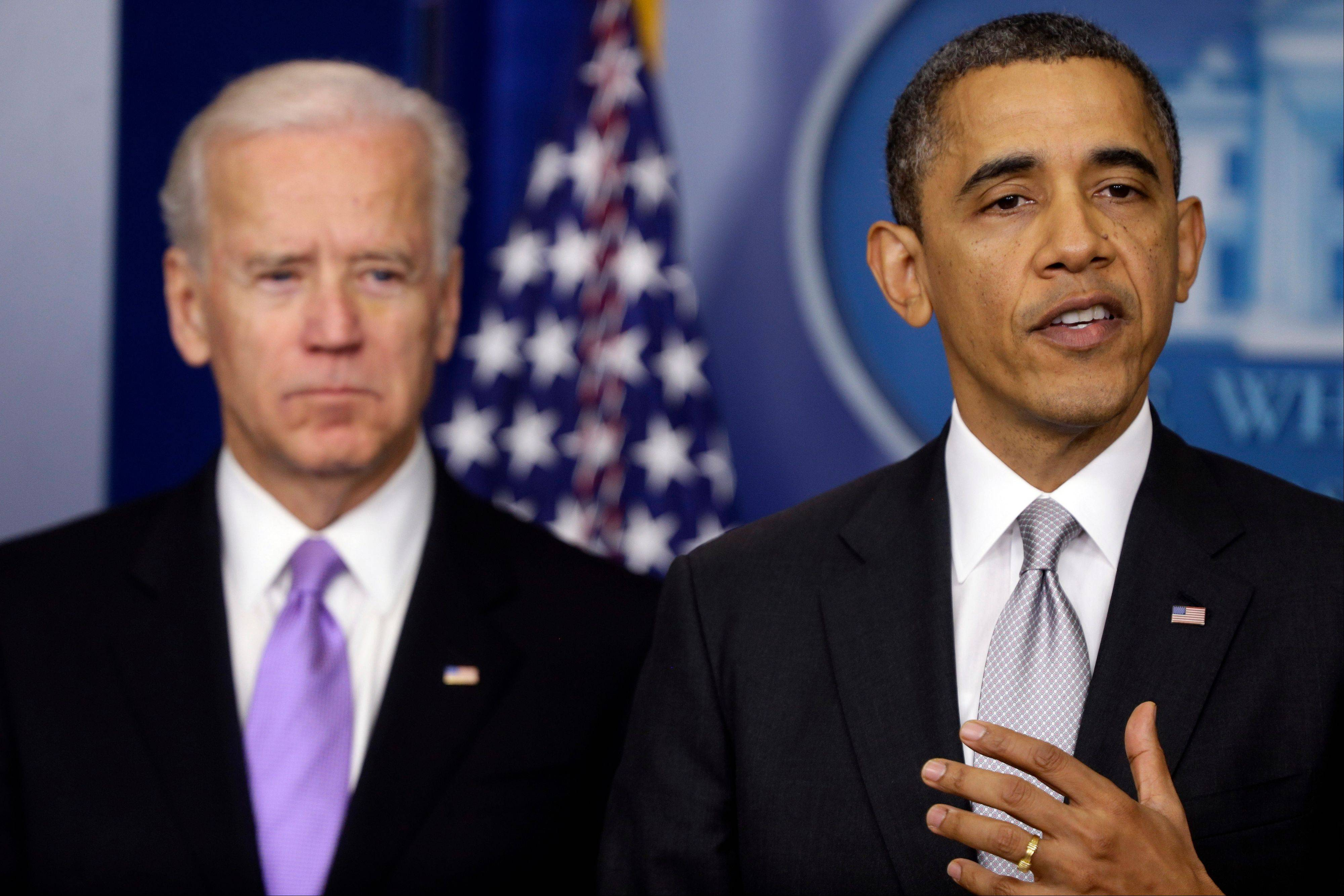 President Barack Obama stands with Vice President Joe Biden as he makes a statement Wednesday, Dec. 19, 2012, in the Brady Press Briefing Room at the White House in Washington, about policies he will pursue following the massacre at Sandy Hook Elementary School in Newtown, Ct. Obama is tasking Vice President Joe Biden, a longtime gun control advocate, with spearheading the effort.