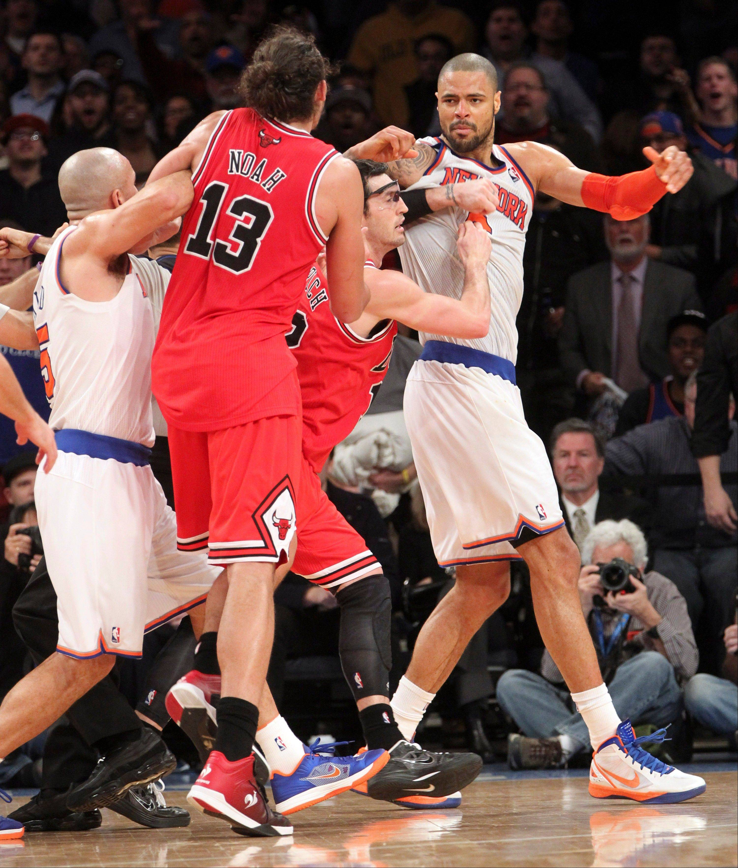 New York Knicks guard Jason Kidd, left, and Bulls guard Kirk Hinrich, second from right, separate Bulls forward Joakim Noah (13) and Knicks center Tyson Chandler, right, Friday during the second half at Madison Square Garden in New York. The Bulls defeated the Knicks 110-96.