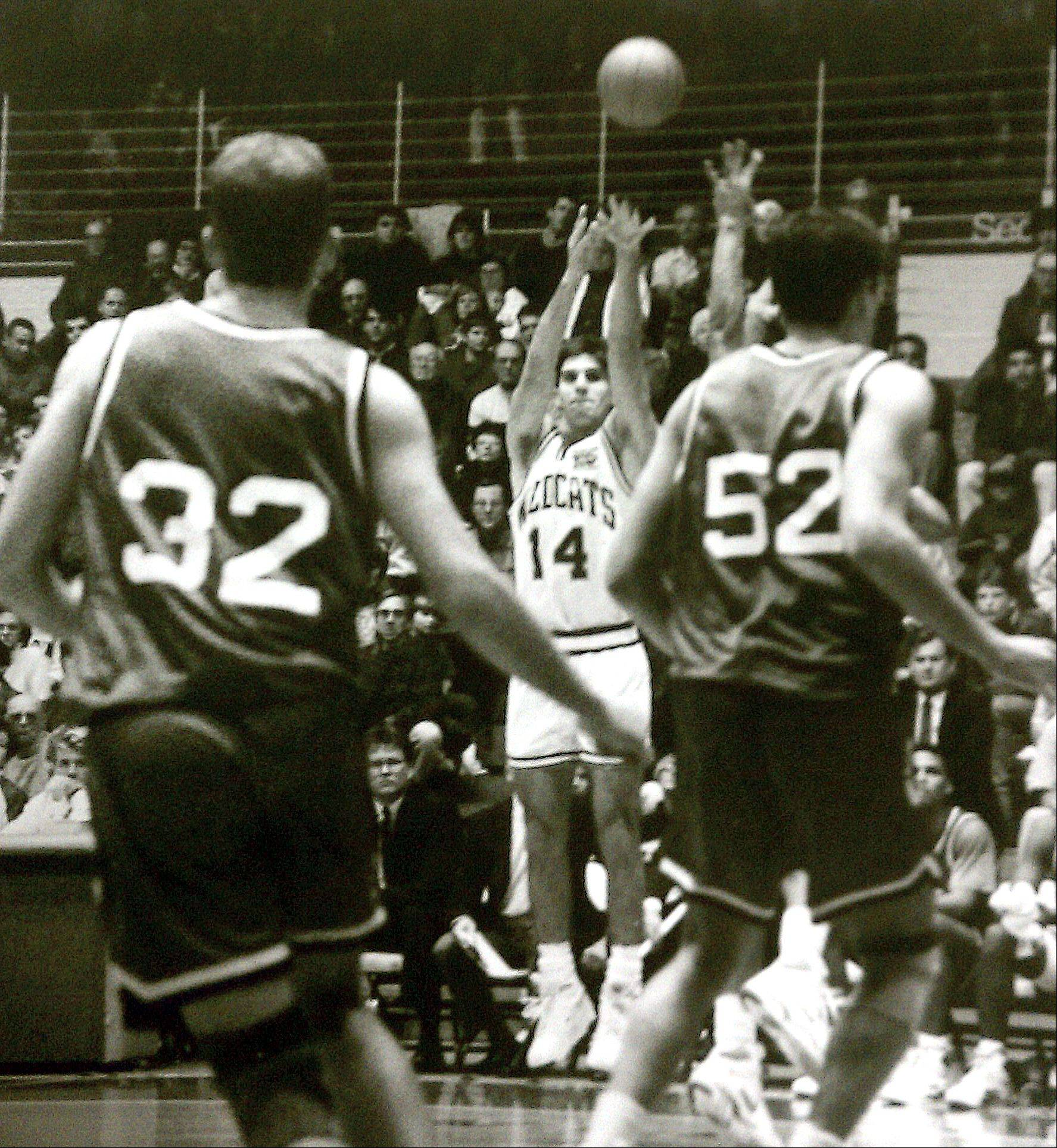 Former Fremd basketball star Todd Leslie makes a three-point-shot for the Northwestern Wildcats. Leslie holds the NCAA record for consecutive three-pointers made with 15 in a four-game span in December 1990. A guard from Auburn has 11 straight going into today's action.
