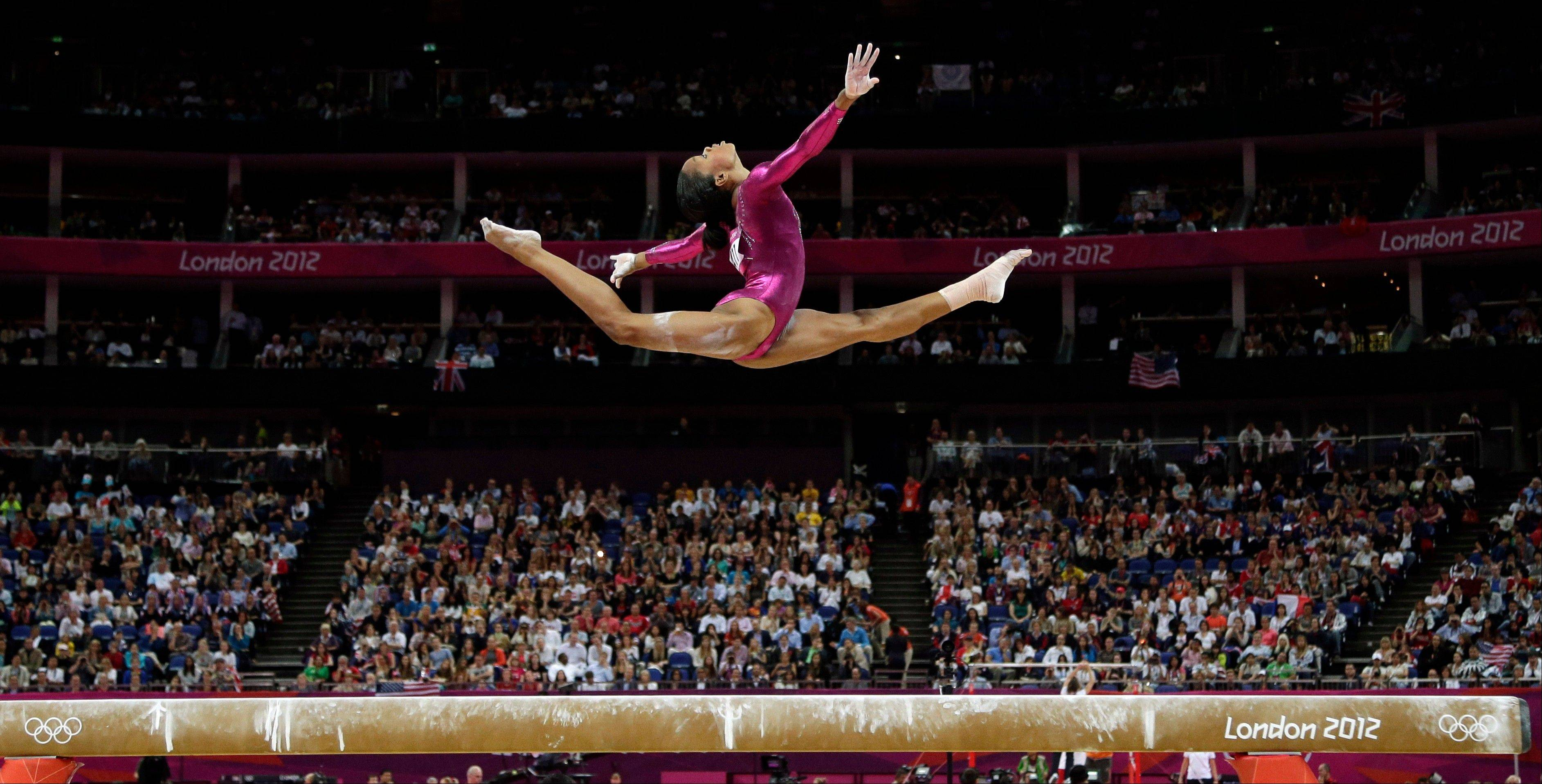 Gabrielle Douglas performs on the balance beam during the artistic gymnastics women's individual all-around competition at the 2012 Summer Olympics in London. Douglas is The Associated Pressí 2012 female athlete of the year.