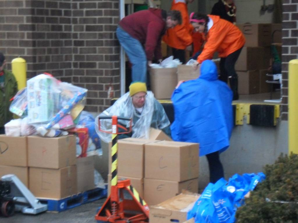 Volunteers load food for needy families on HSP's on December 15th.