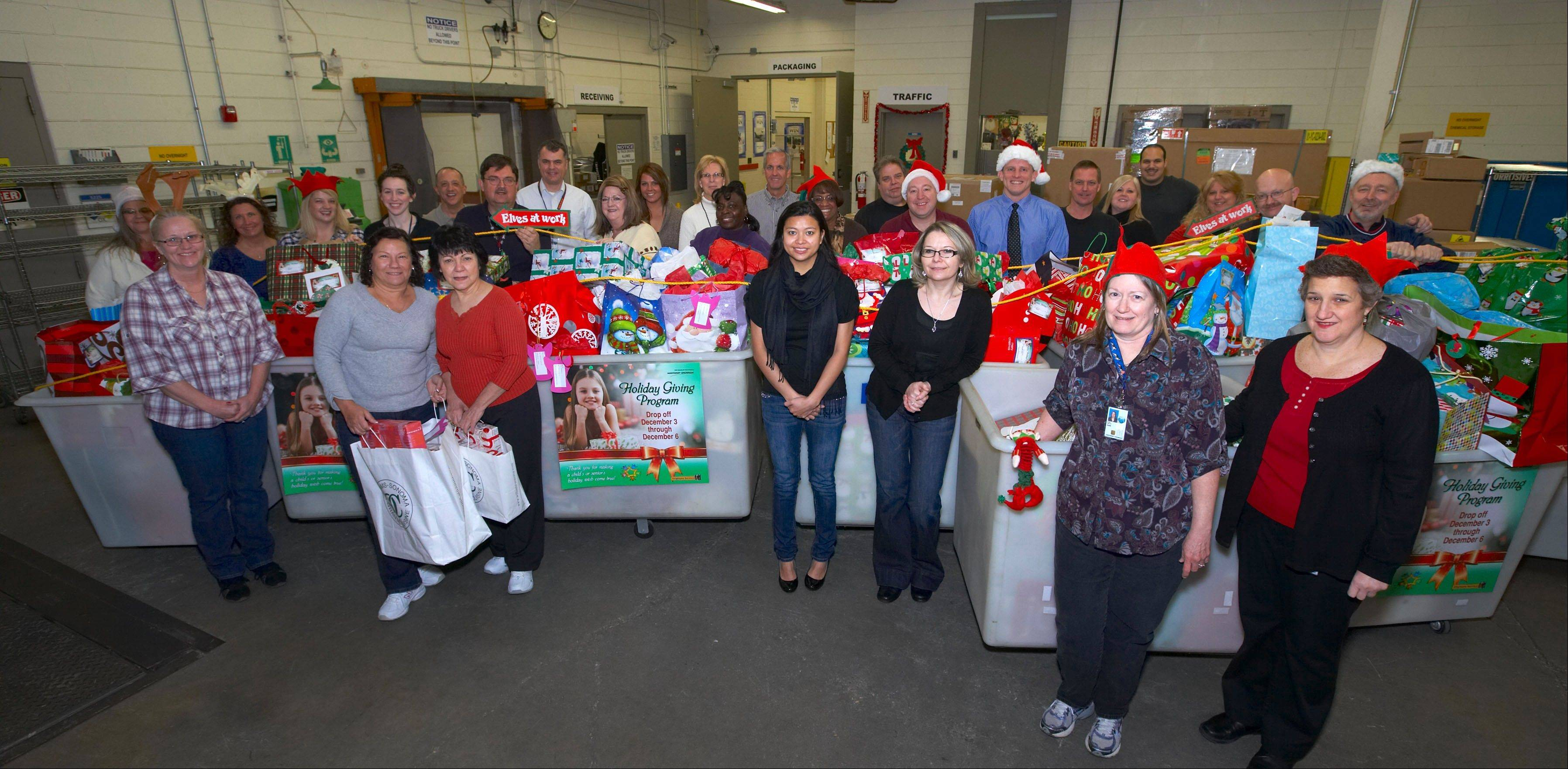 Northrop Grumman employees in Rolling Meadows prepare to deliver gifts to 220 Chicago-area residents during the campus' 20th annual holiday gift drive.
