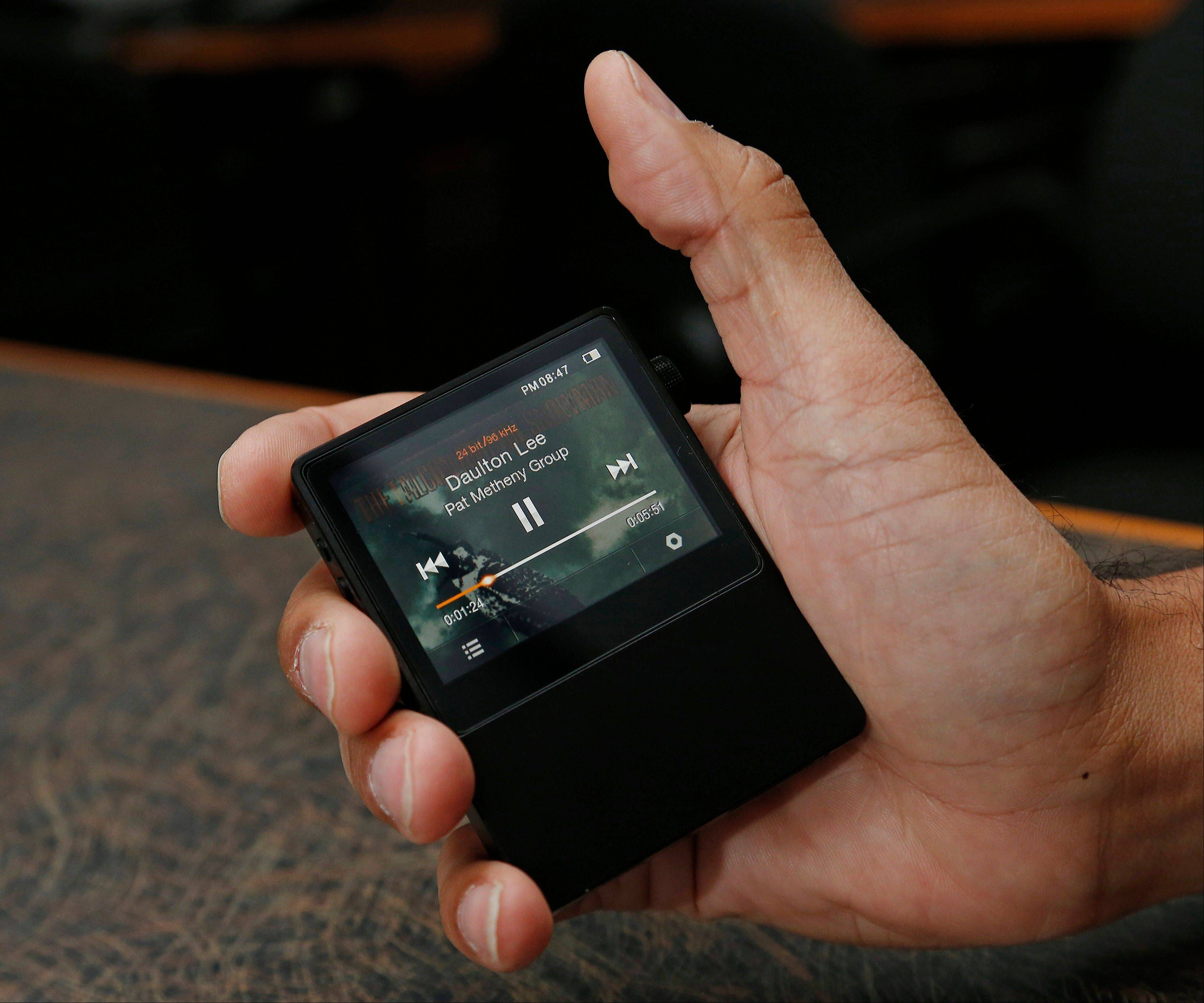 The Astell & Kern AK100 is a portable music player retailing for $699 and is capable of playing 24-bit, audiophile-quality digital music files.