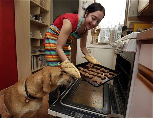 New York pet columnist Sarah Zorn says her dog Rowdy enjoys his gingerbread holiday dog biscuits.