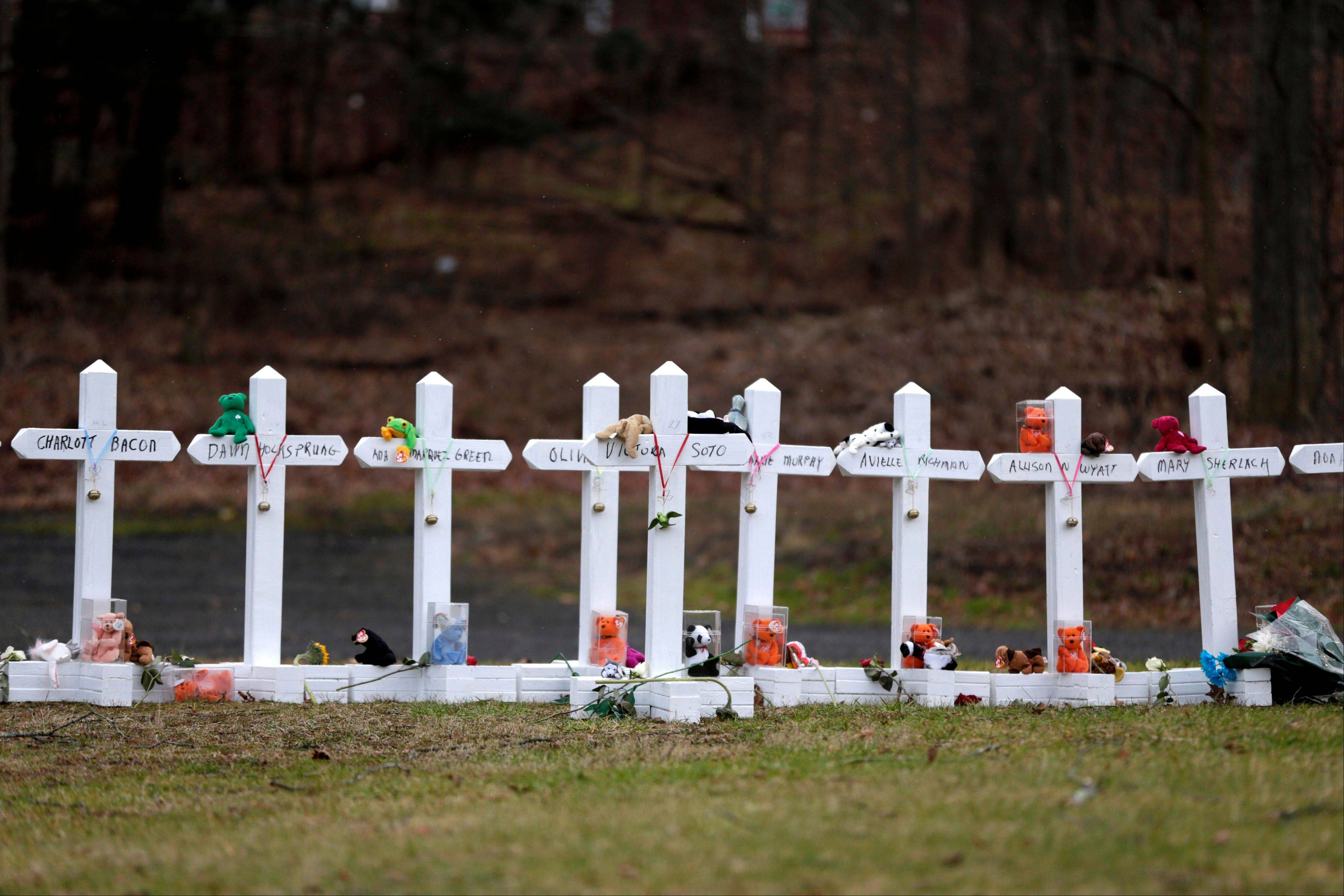 Crosses bearing the names of the Newtown shooting victims are displayed Saturday in the Sandy Hook village of Newtown, Conn.