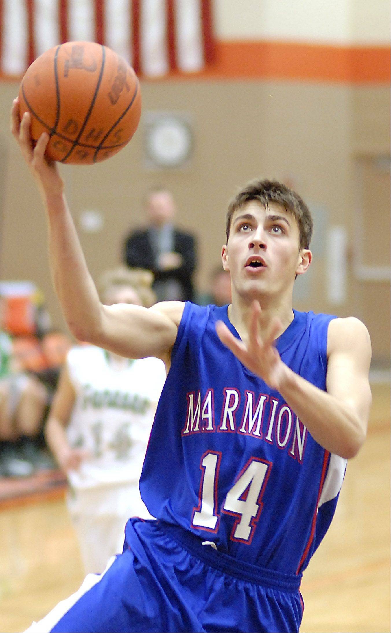 Marmion�s Alex Theisen sinks a shot in the fourth quarter of the DeKalb tournament on Saturday, December 22.