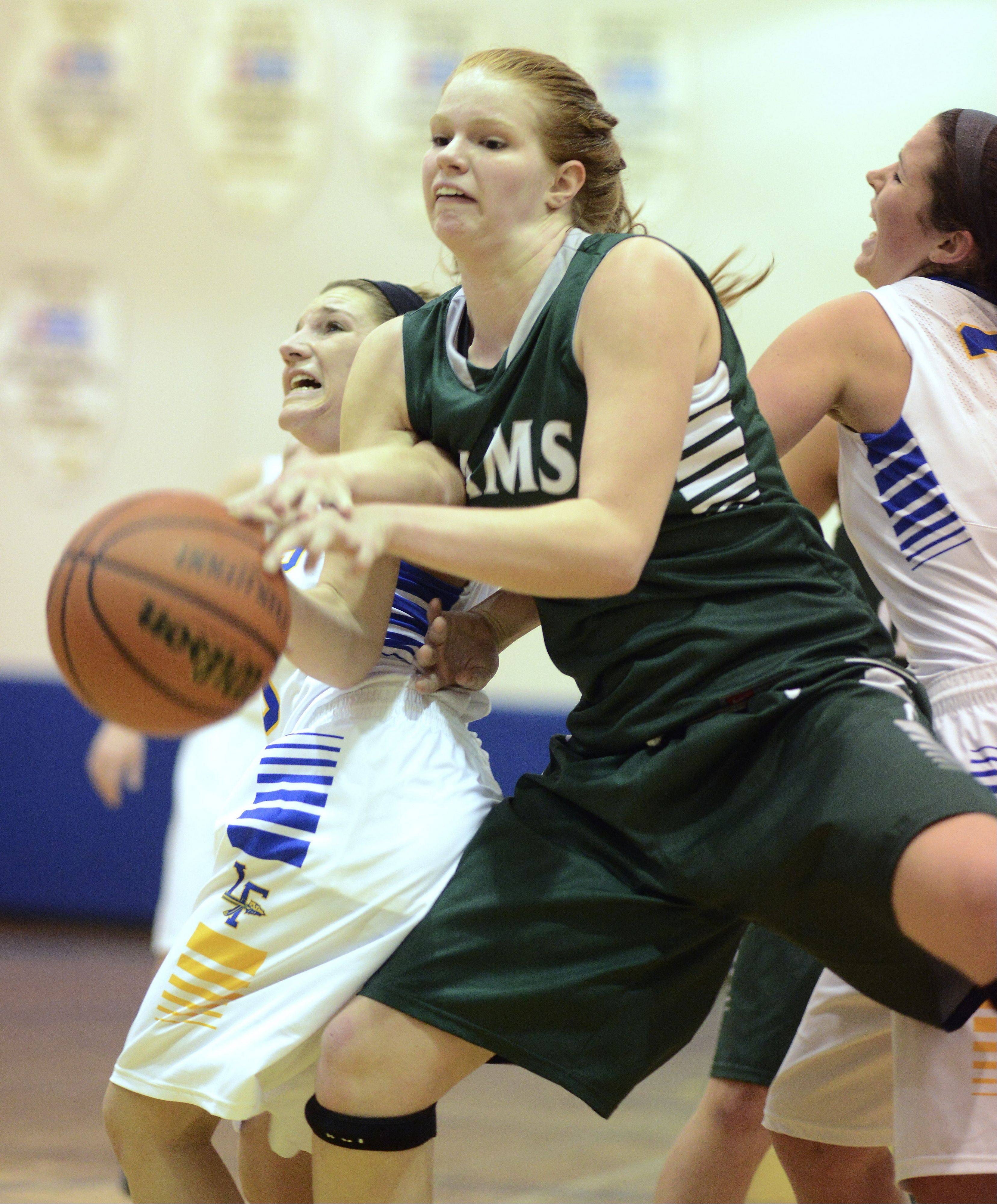 Grayslake Central�s Morgan Dahlstrom, middle, draws contact while trying to drive in between Lake Forest�s Gabby Perino, left, and Annie Keller during Saturday�s game at Warren.