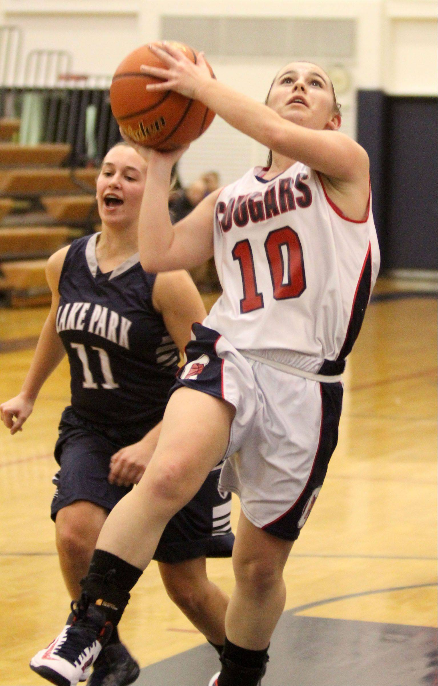 Conant�s Sidney O�Keefe puts up a breakaway layup with Lake Park defender Emily Duckhorn trailing the play on Saturday.