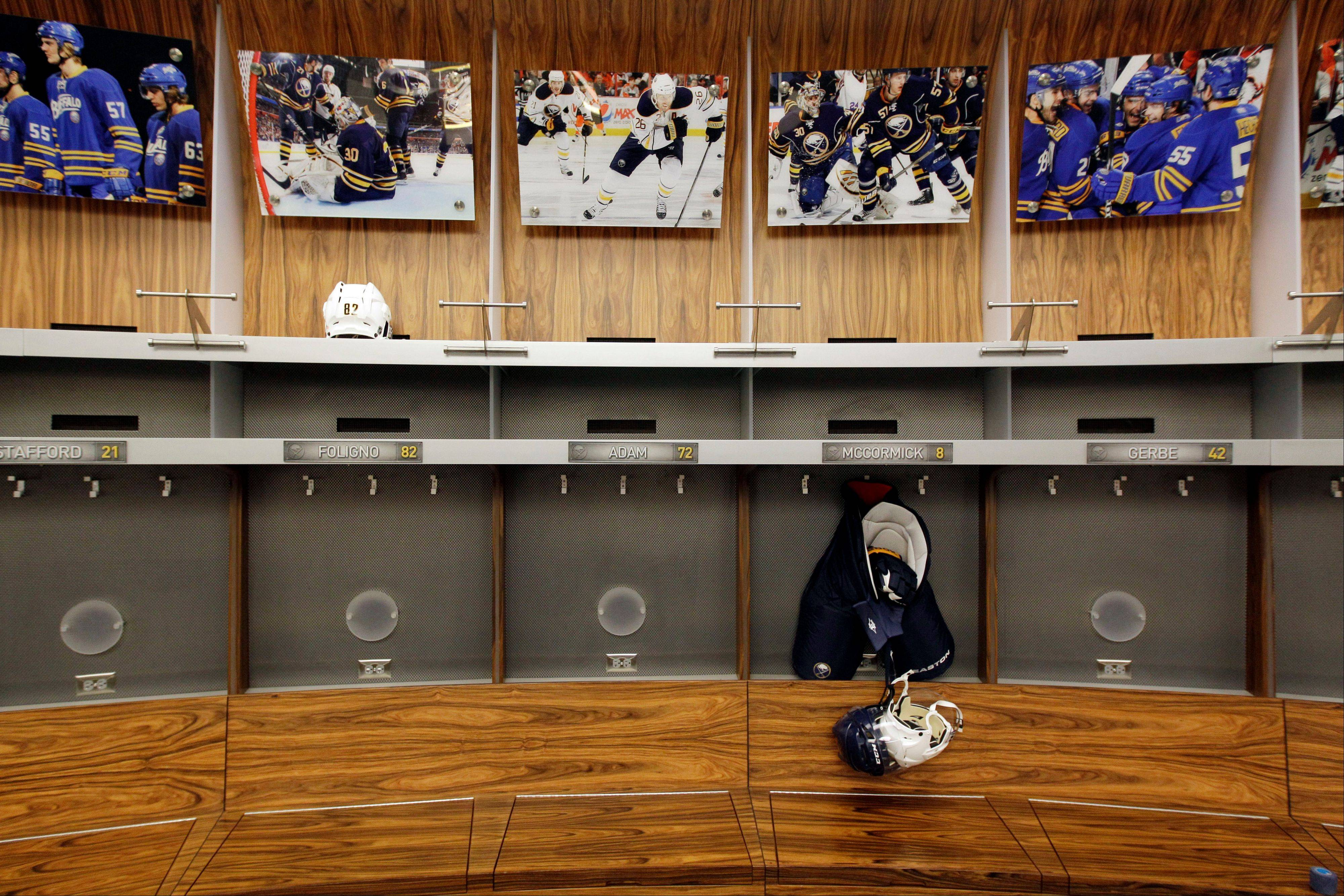 An empty locker room is shown during the NHL labor lockout at the First Niagara Center, home of the Buffalo Sabres, in Buffalo, N.Y. The NHL lockout that's already wiped out the first three months of the season is taking its toll on Buffalo businesses. And it's no different in many of the NHL's 29 other markets.