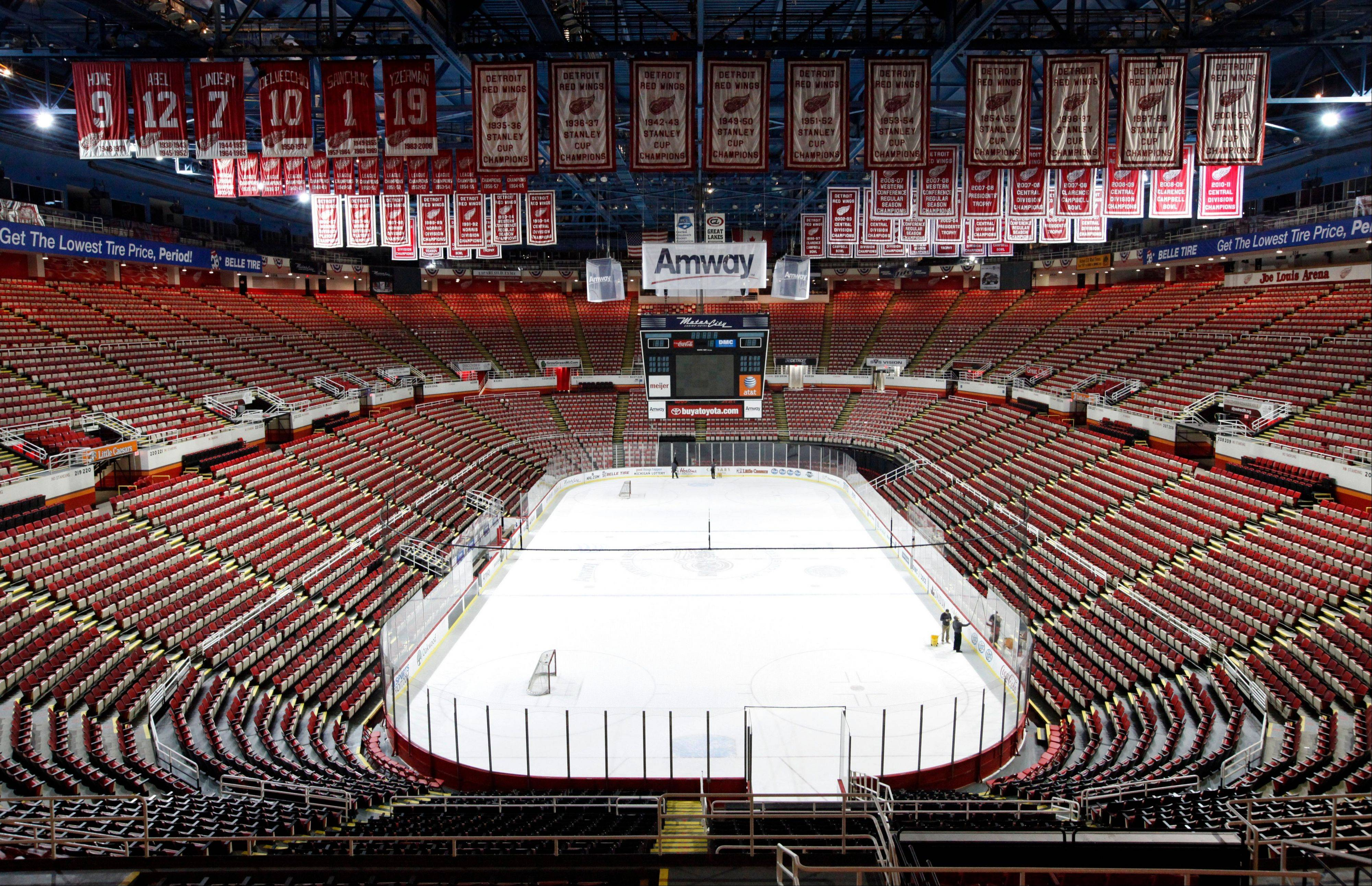 Championship banners and retired numbers of the Detroit Red Wings hockey team hang from the rafters above the ice at Joe Louis Arena in Detroit. The NHL lockout that's already wiped out the first three months of the season is taking its toll on small businesses in many of the NHL's markets.