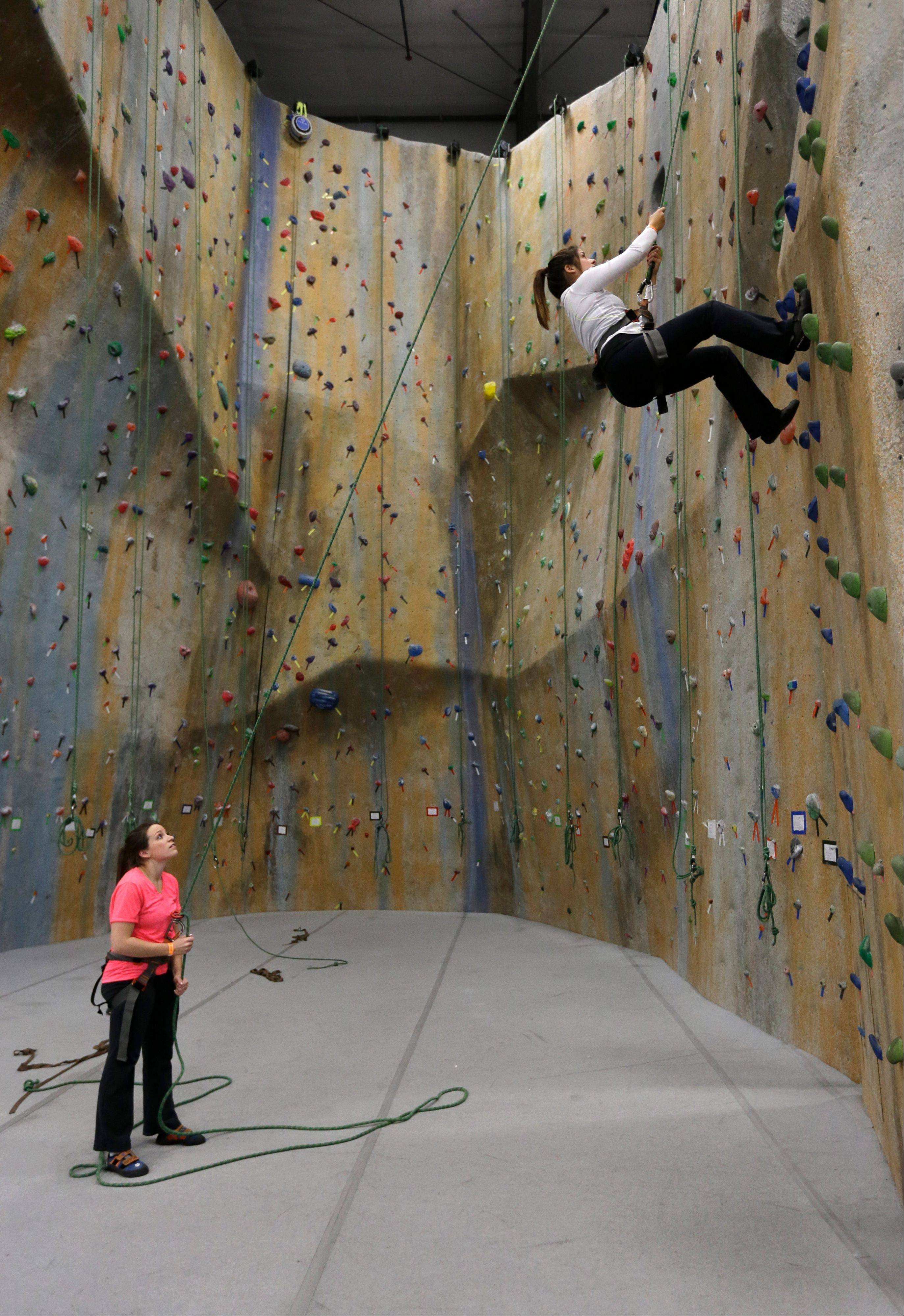 Ashley Van Patten, left, belays for Kelly Harrigan at The Edge Halfmoon indoor climbing center in Halfmoon, N.Y.