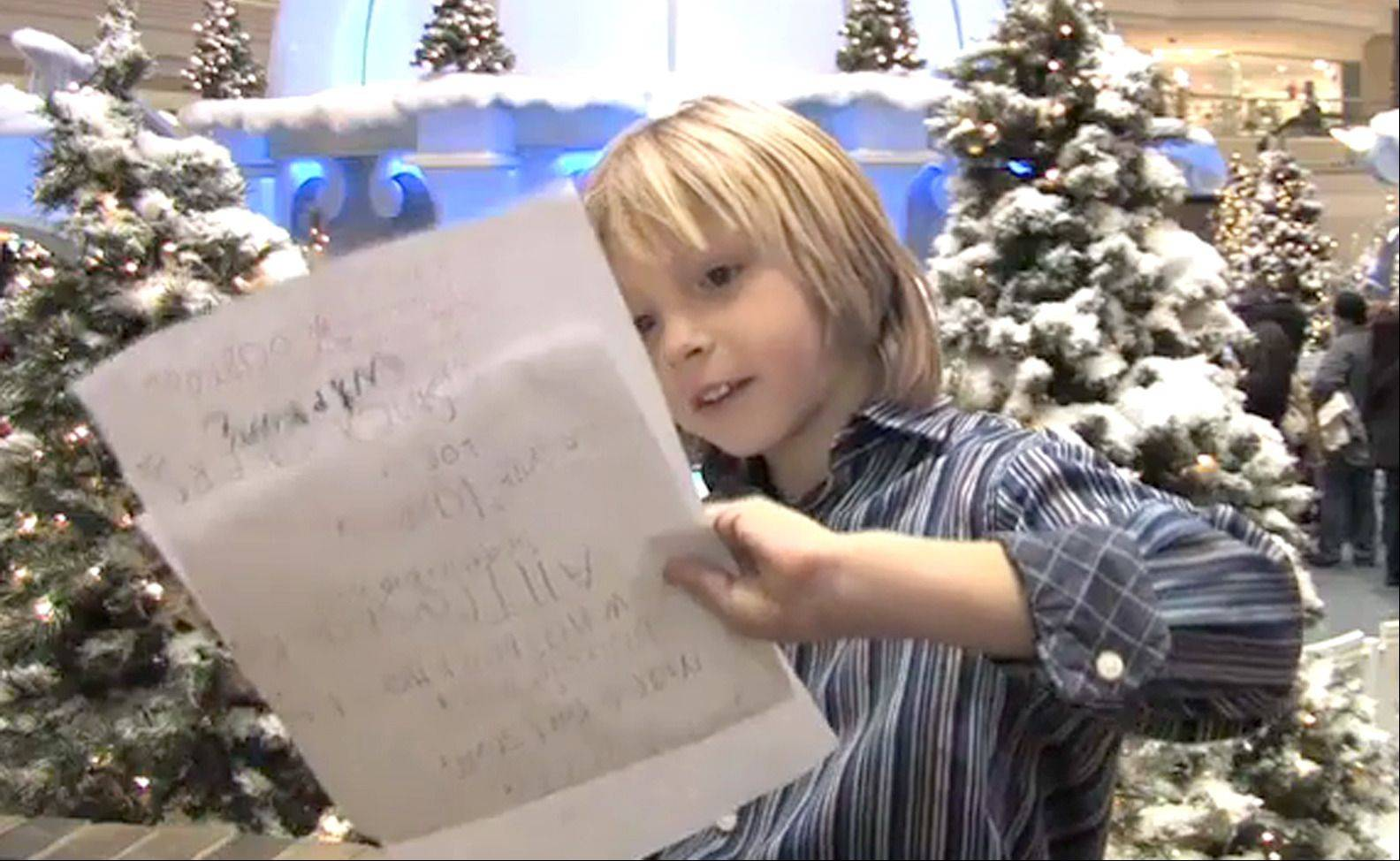 Cannon Dudley, 6, of Palatine checks his Christmas wish list while preparing to visit with Santa at Woodfield Mall in Schaumburg. Dudley is wishing for Angry Birds stuff, an iPhone, a 3-D DS, the Avengers movie ...
