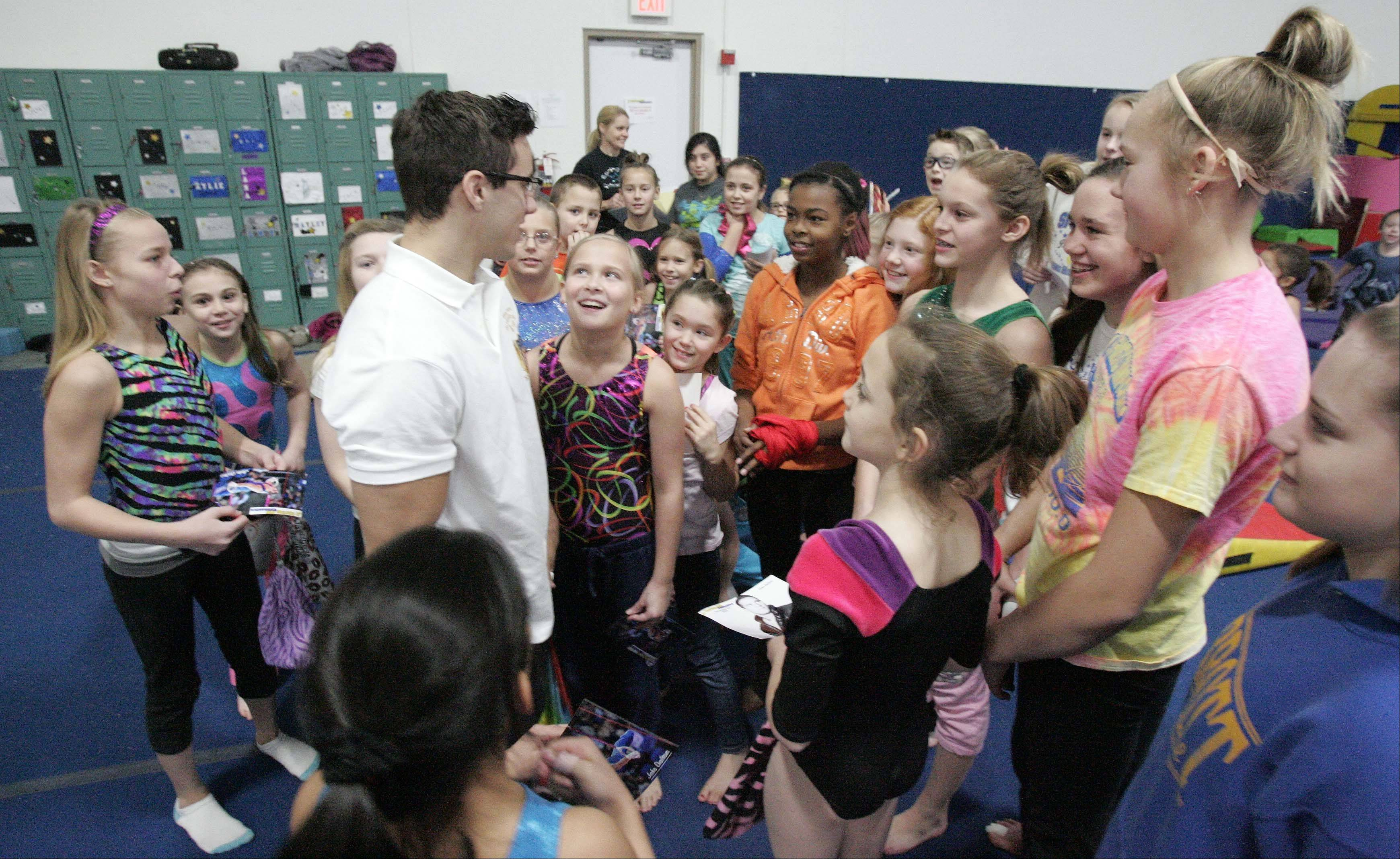 Olympic gymnast Jake Dalton meets young fans Saturday during his appearance at Spring Hill Gymnastics in Elgin.