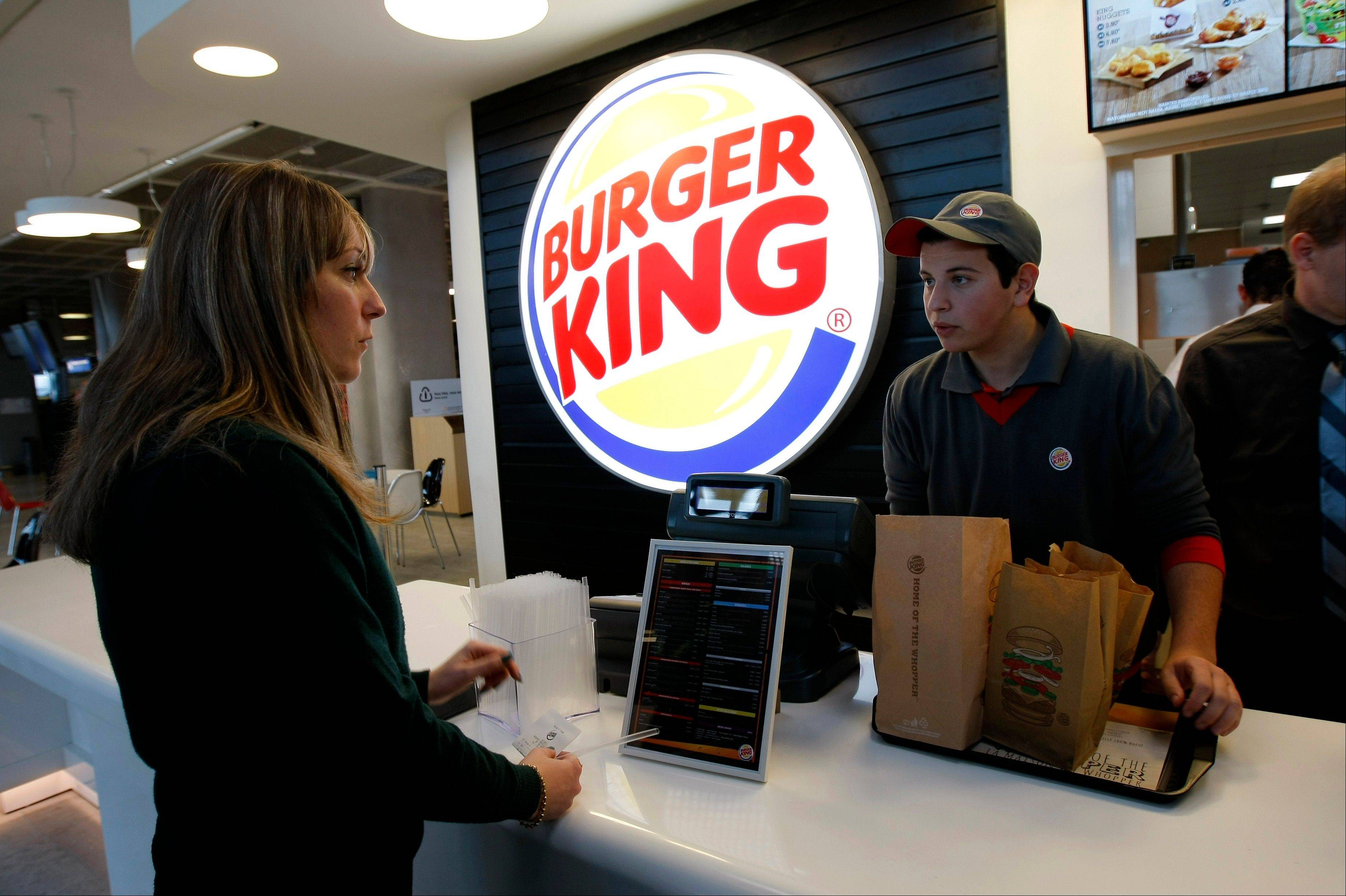 A customer purchases a meal at a Burger King restaurant Saturday in Marseille-Provence airport, in Marignane, France.