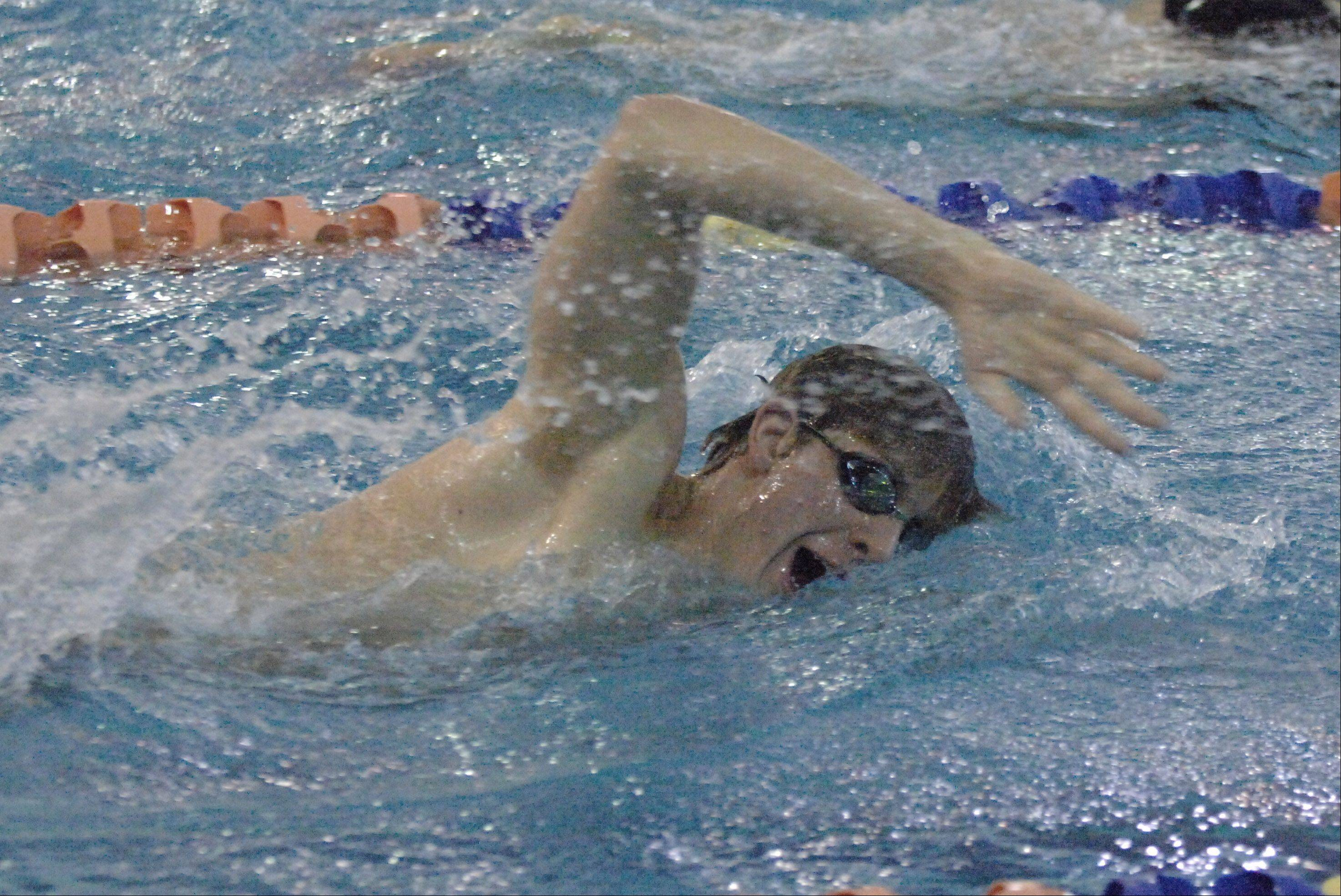 Adam Nyland of Naperville North swims the 1000 free during the Naperville North College Events boys swimming invitational Saturday.