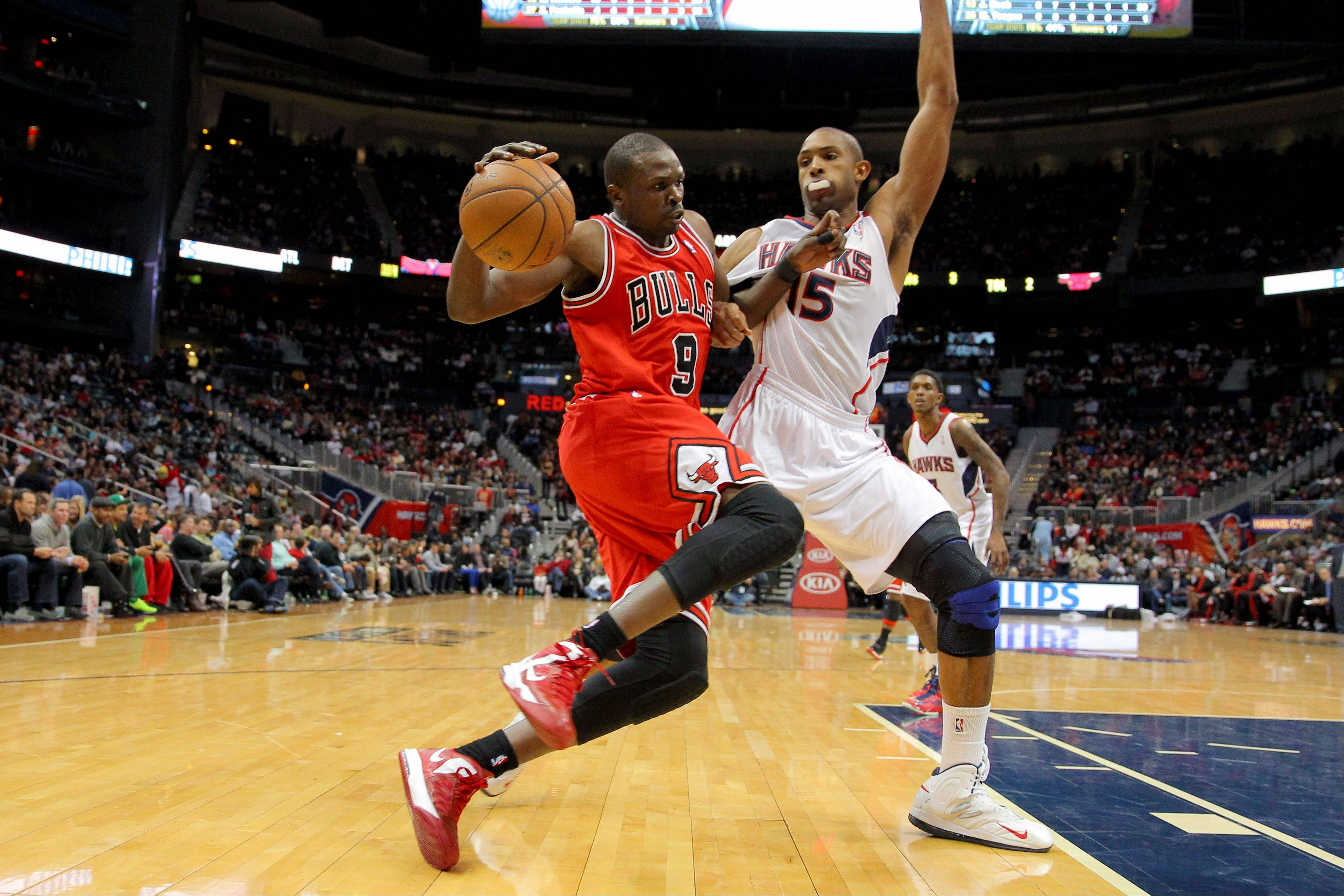 Chicago Bulls forward Luol Deng (9) drives to the basket against Atlanta Hawks center Al Horford (15) in the second half Saturday in Atlanta. The Hawks won 92-75.