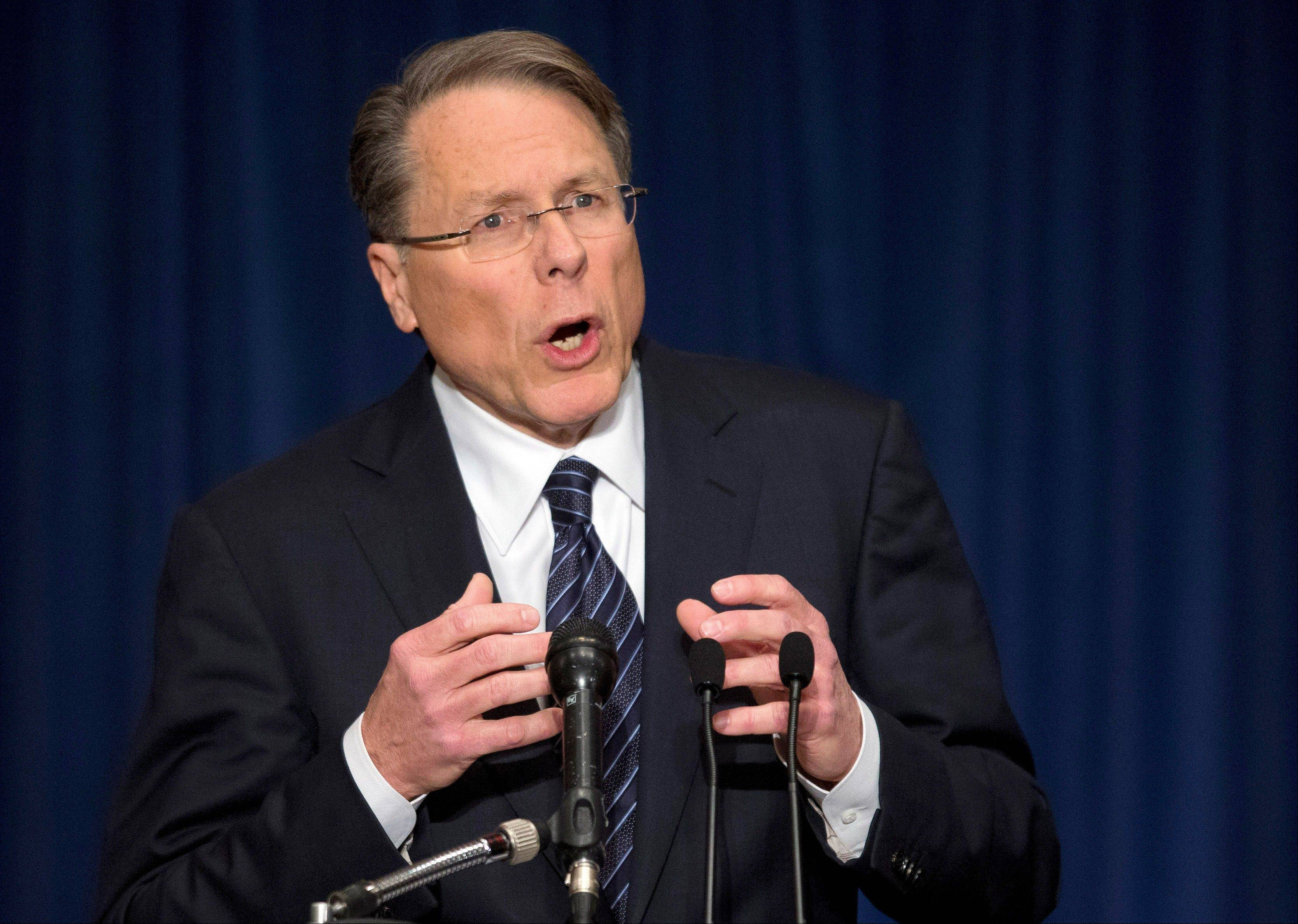 "The National Rifle Association executive vice president Wayne LaPierre, gestures during a news conference in response to the Connecticut school shooting on Friday, Dec. 21, 2012 in Washington. The nation's largest gun-rights lobby is calling for armed police officers to be posted in every American school to stop the next killer ""waiting in the wings."""