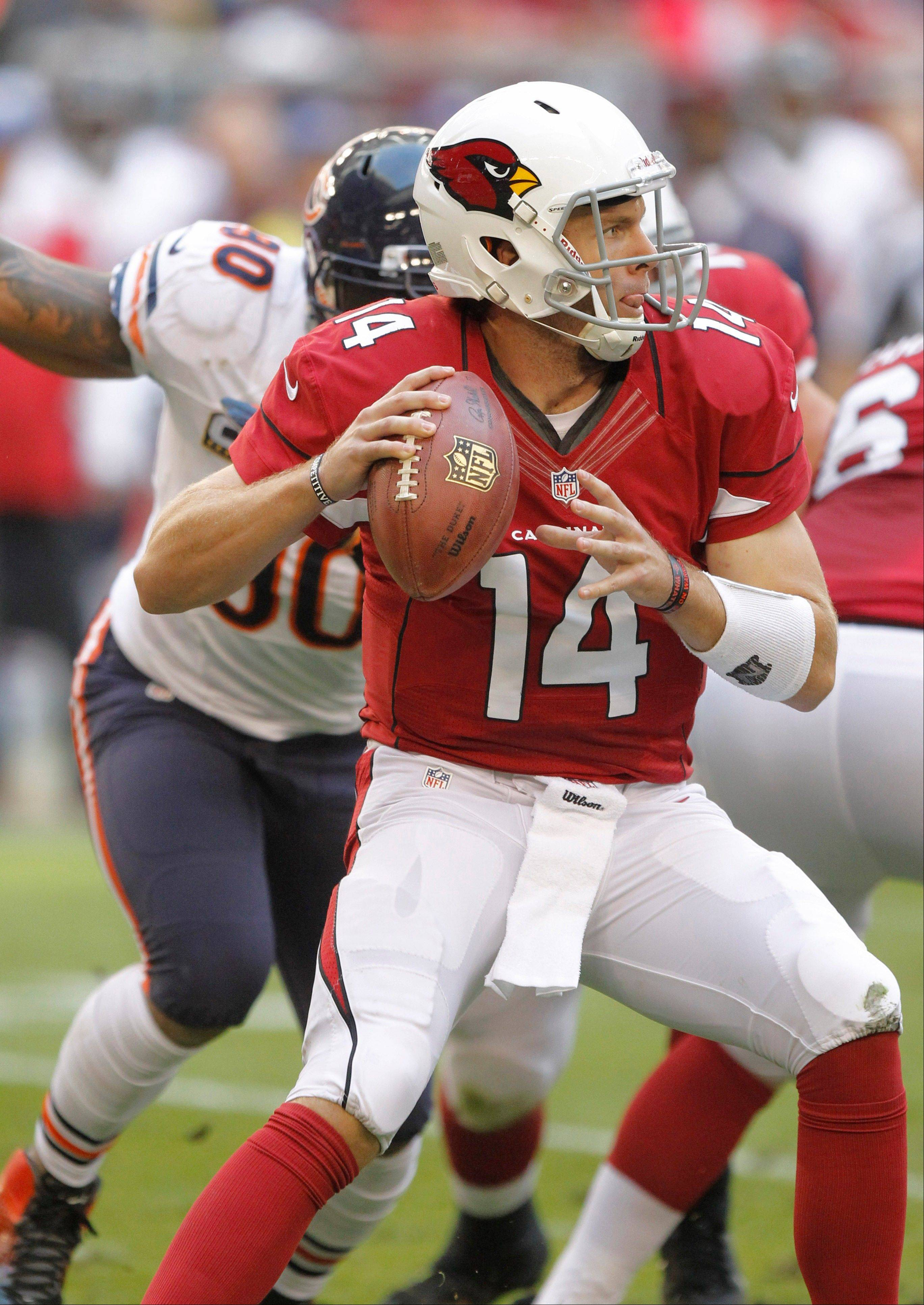 The Bears� Alonzo Spellman closes in on Ryan Lindley as the Cardinals� quarterback looks for an open receiver.